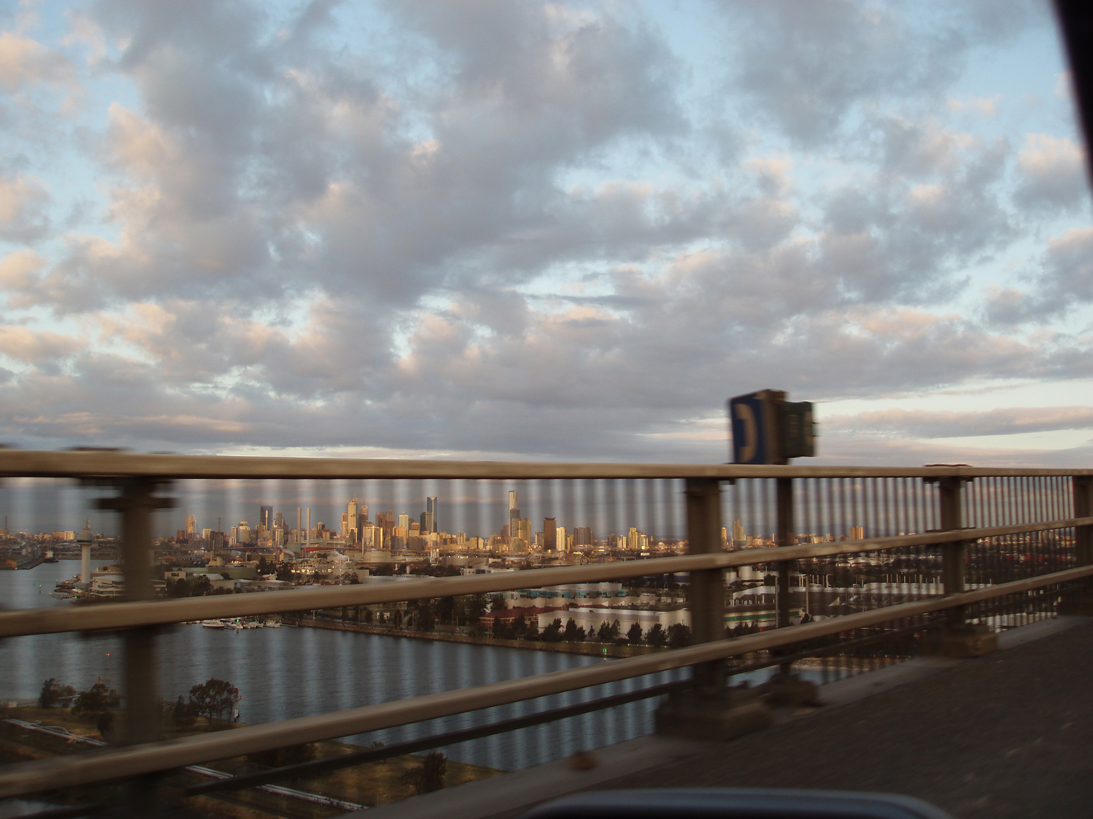 View from Car Traveling Across Bridge into City of Melbourne, Australia at Dusk