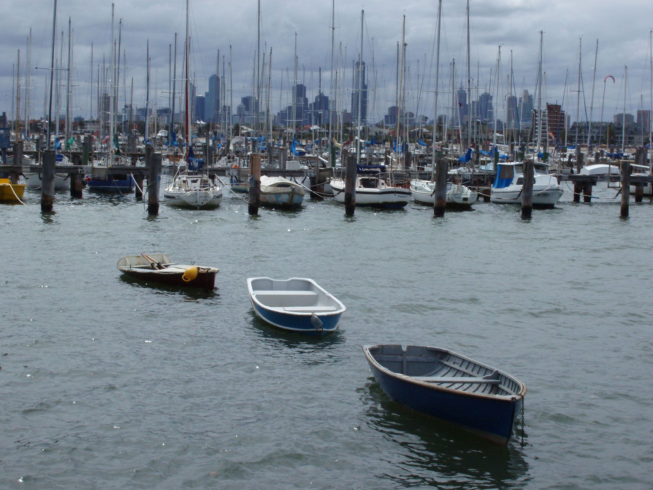 Small Vintage Boats Floating at Beautiful St Kilda Marina in Melbourne, Australia.