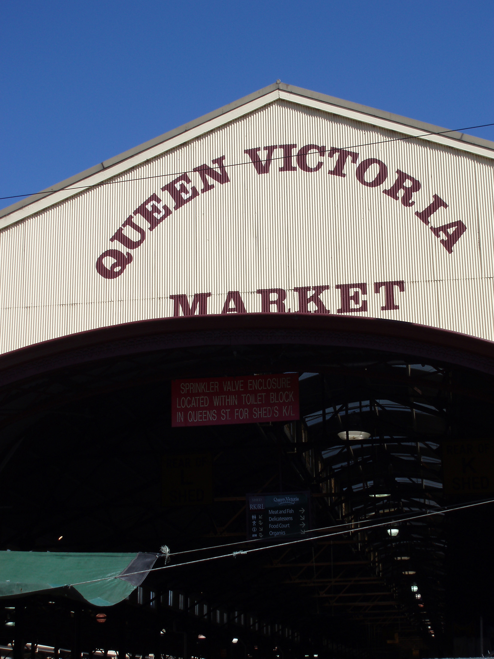 Signage of Famous Queen Victoria Market in Melbourne on Blue Sky Background.