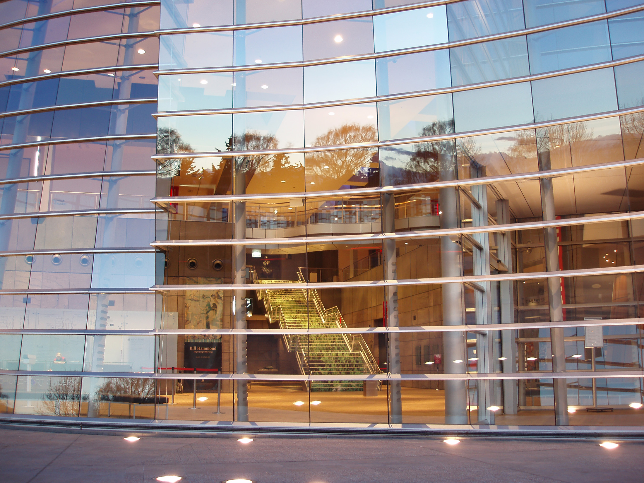 reflective glass font of the christchurch art gallery at sunset