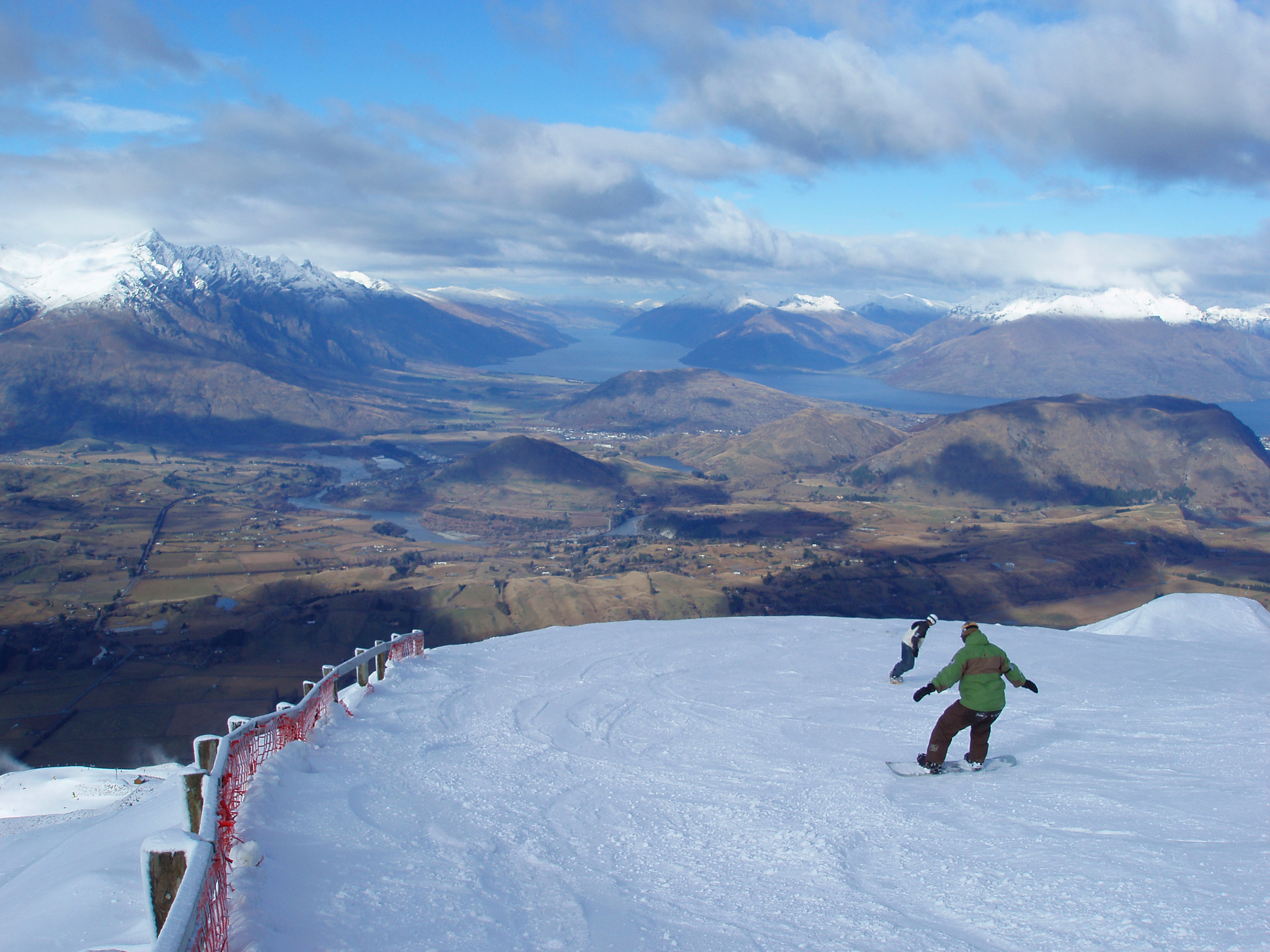 spectacular place for winter sports, snowboarder on the piste at coronet peak