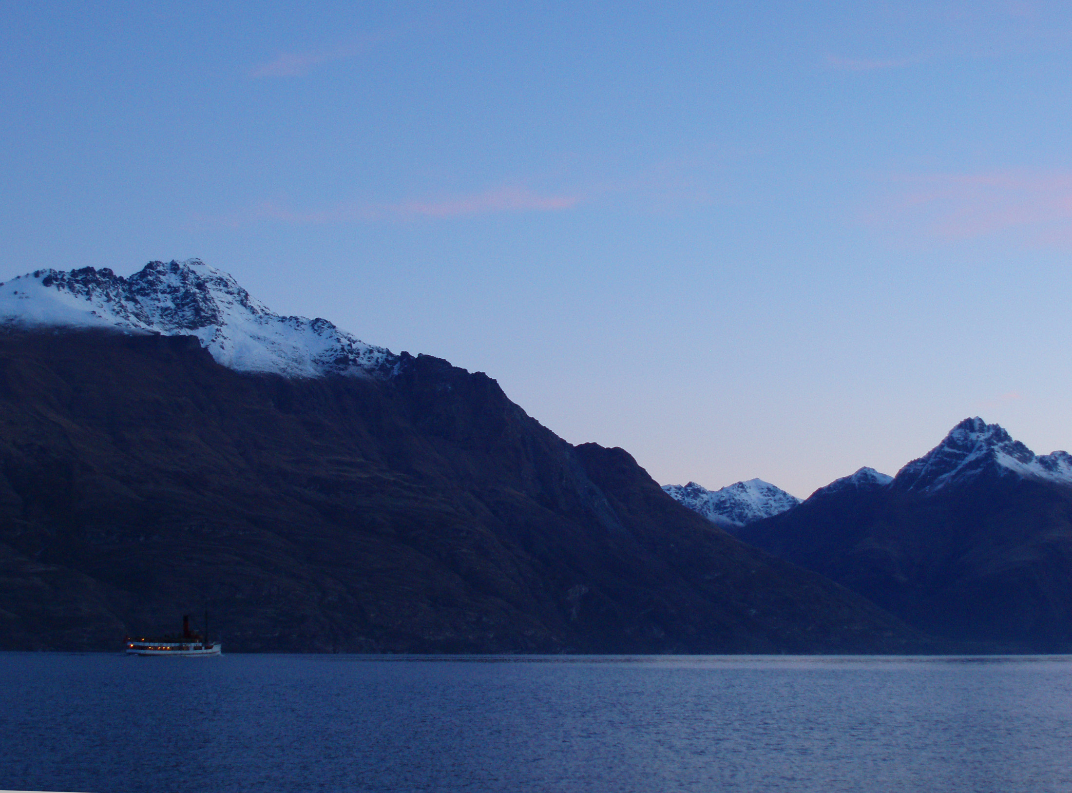the TSS earnslaw streamer at sunset on lake wakatipu, queenstown in winter