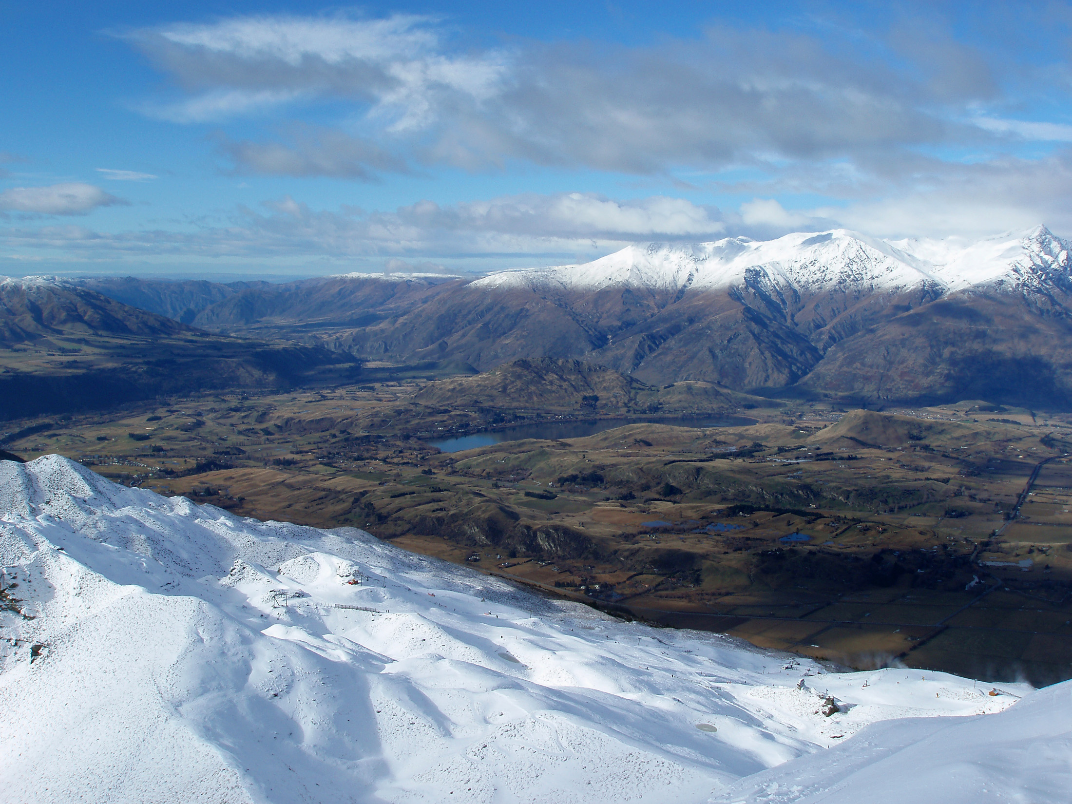 snow covered mountains viewed from coronet peak
