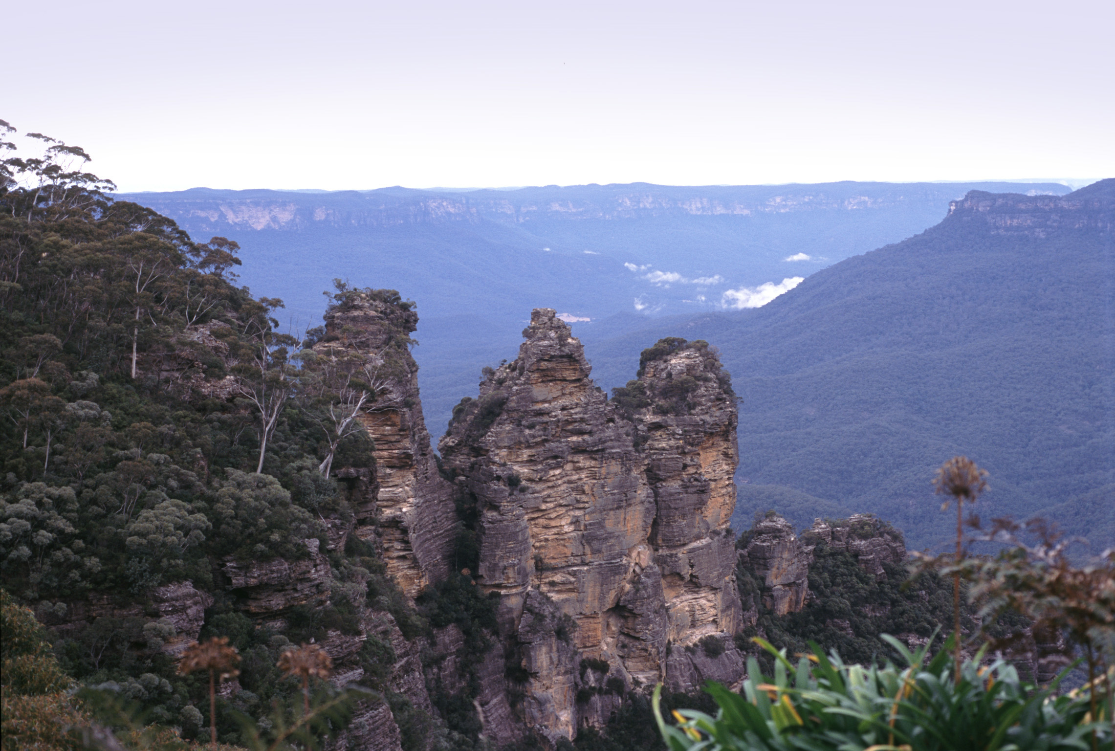 Three Sisters Rock Formation in the Blue Mountains of New South Wales, Australia. Their names are Meehni, Wimlah, and Gunnedoo