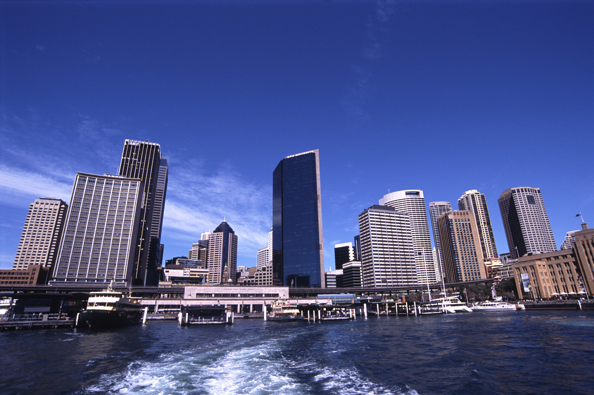 Looking off Back of Boat at Office Towers in Central Business District on Circular Quay, Bennelong Point, Sydney, Australia