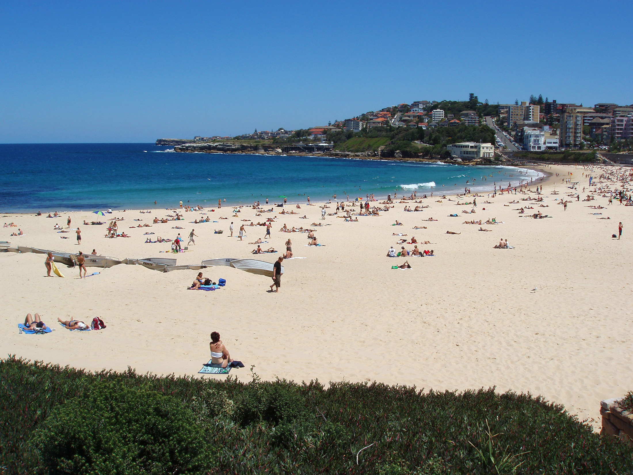 Tourists During Holiday at Famous Coogee Beach with Turquoise Sea Water Located in Australia. Captured in Panorama View.