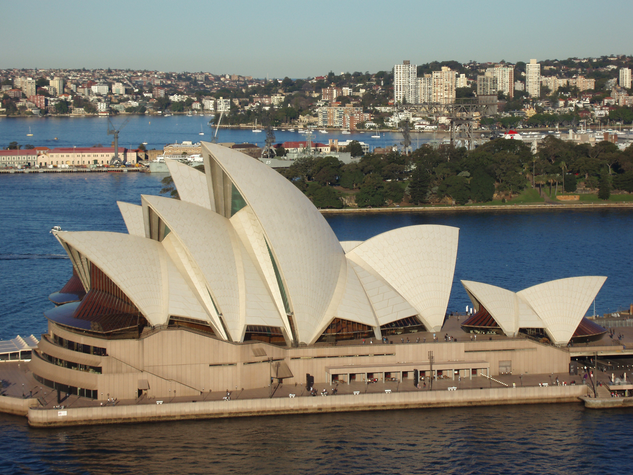 High angle view of the iconic Sydney Opera House, Sydney, Australia, with its shell-like curving roof on the harbor coastline with the city visible behind
