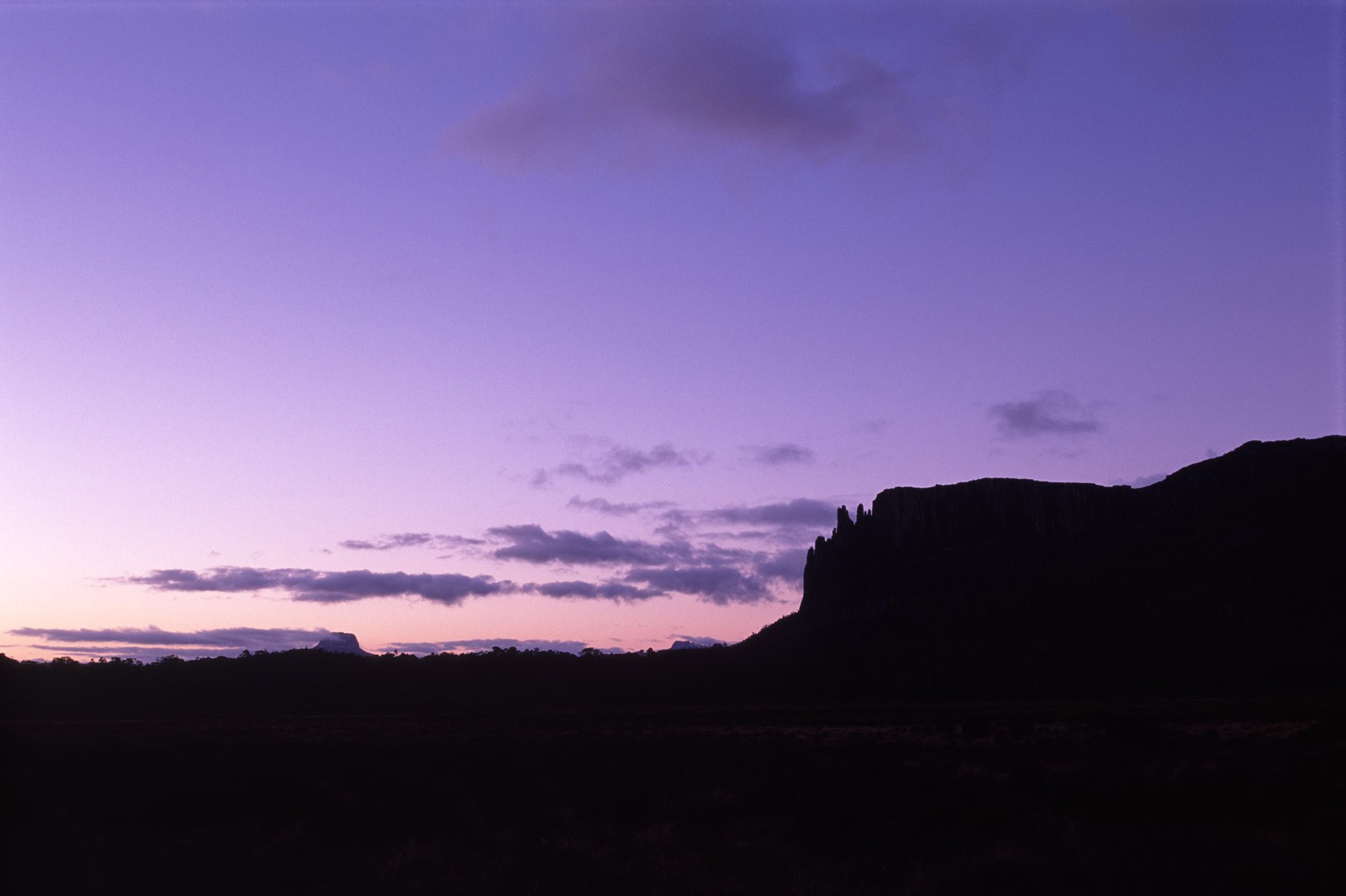 Purple Sunset Over Rocky Silhouetted Tasmania Landscape