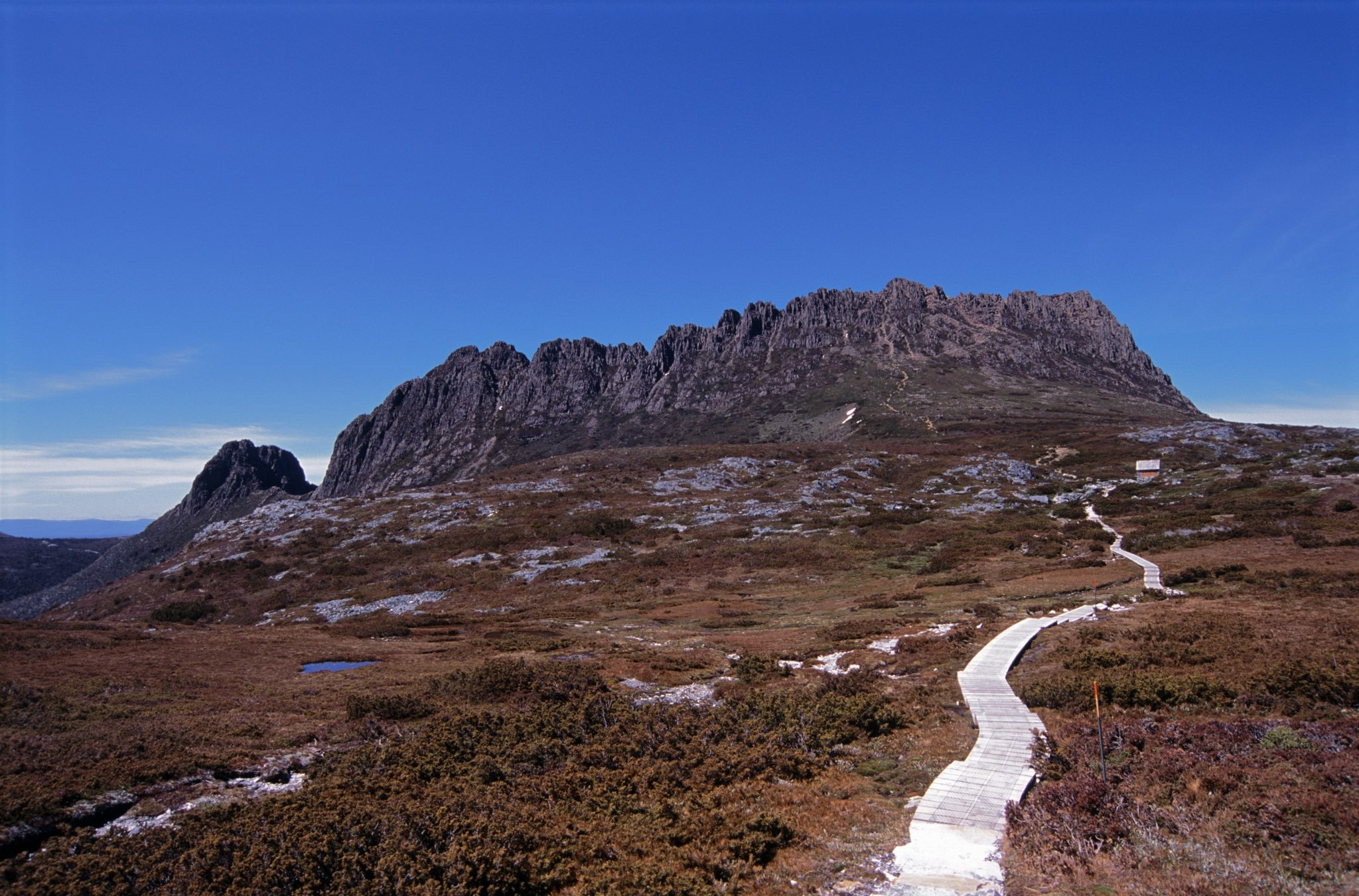 Overland trail with a wooden boardwalk leading to Cradle Mountain, Tasmania in the highlands