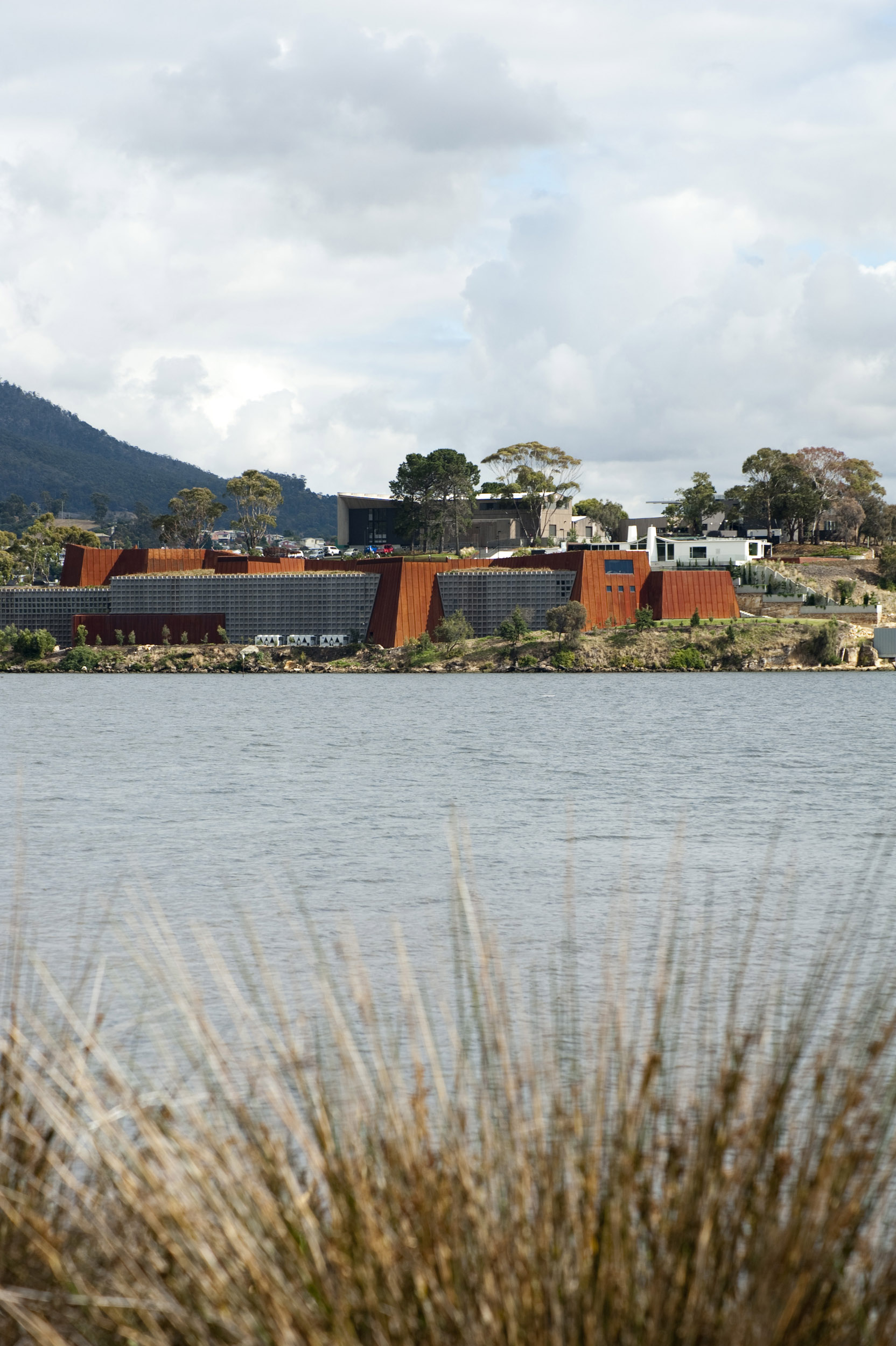 A portrait orientated shot of the Mona art museum and surrounding river in Hobart, Australia.