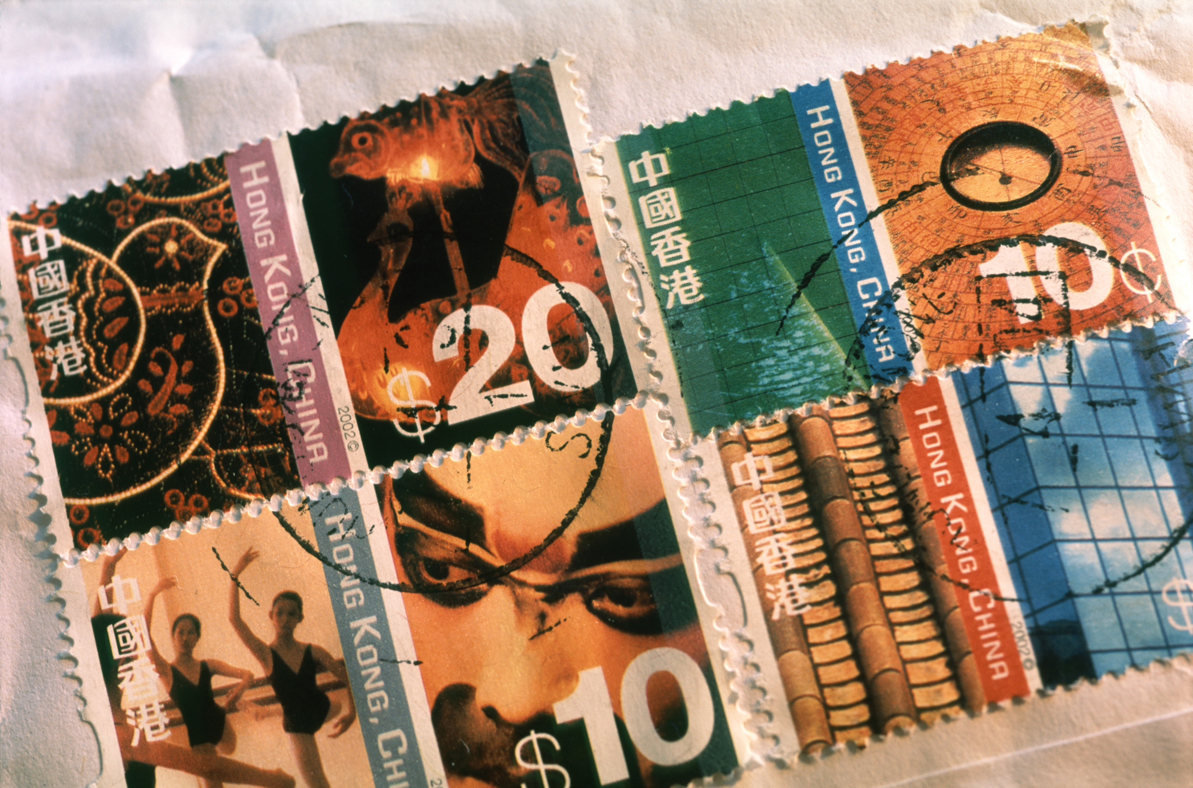 Assorted cancelled Japanese stamps on a packet or letter, close up view