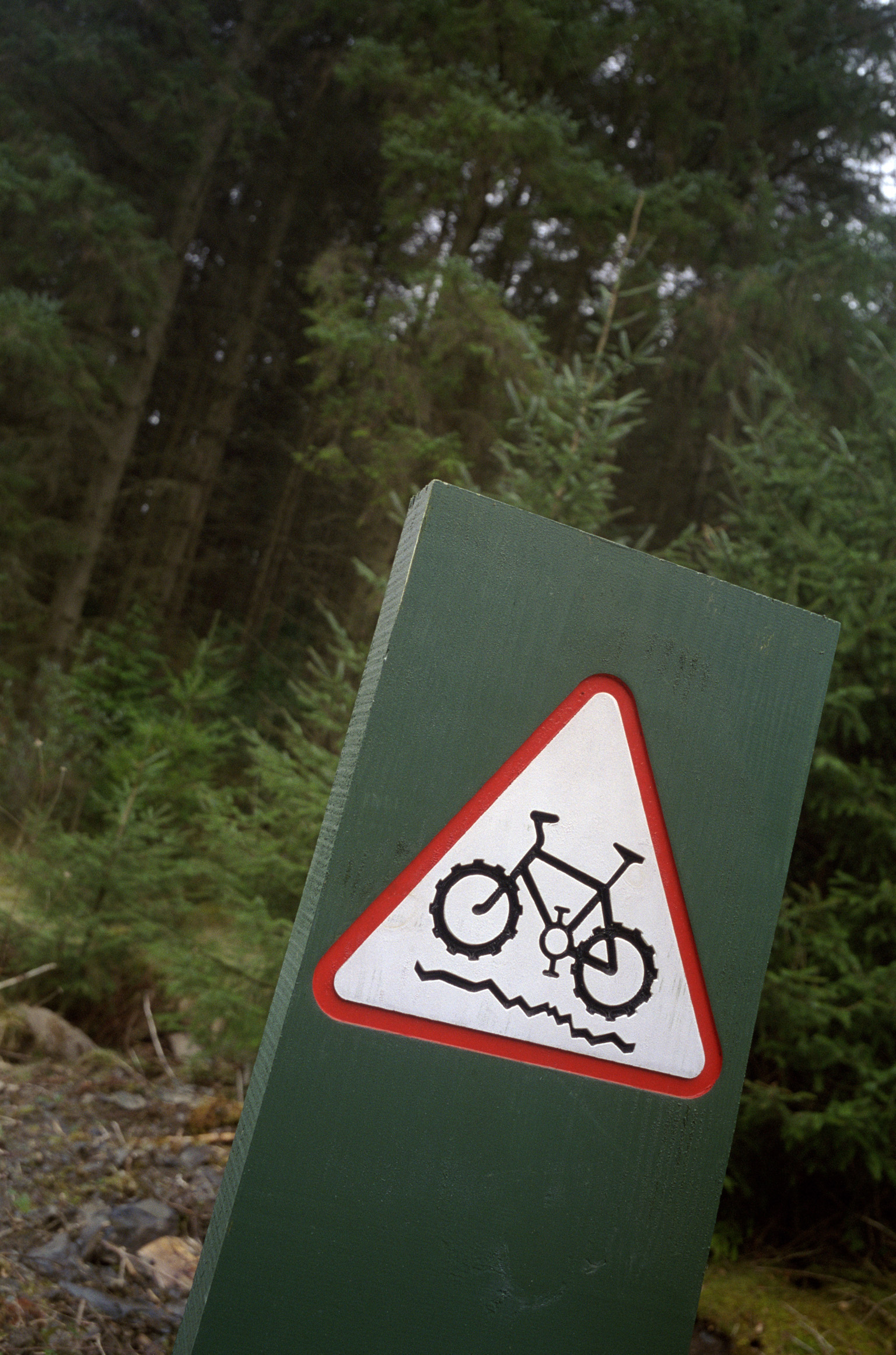 Cycle track sign on a marker showing uneven terrain marking the route of a recreational cycling track