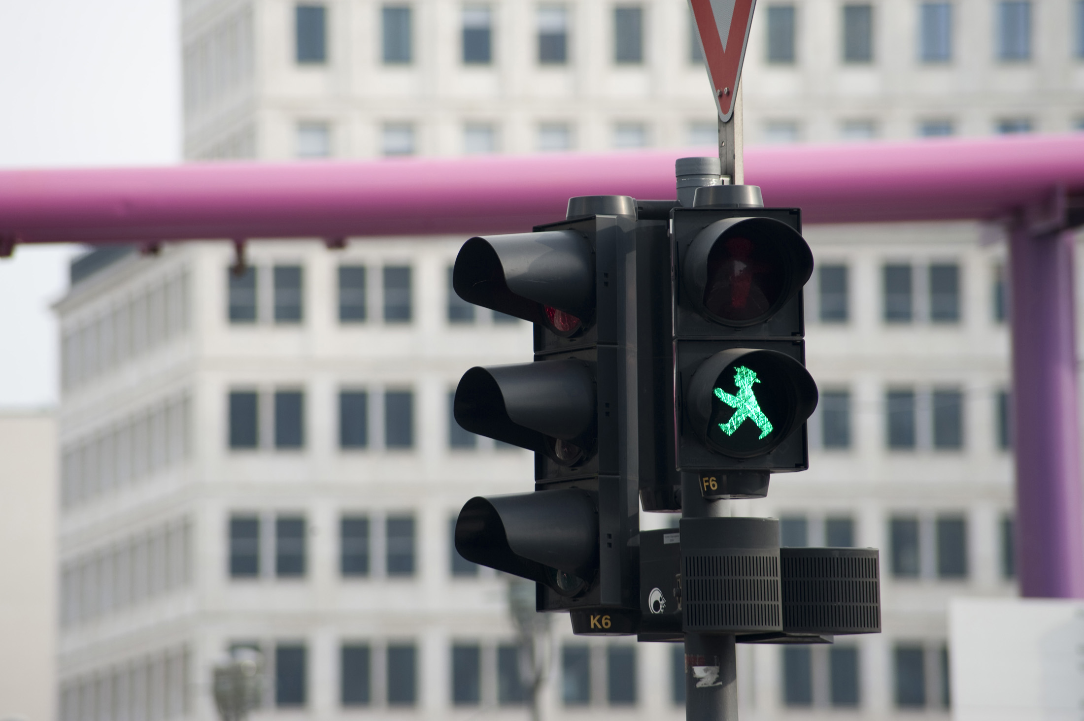 A green ampelmann crossing light in former east germany
