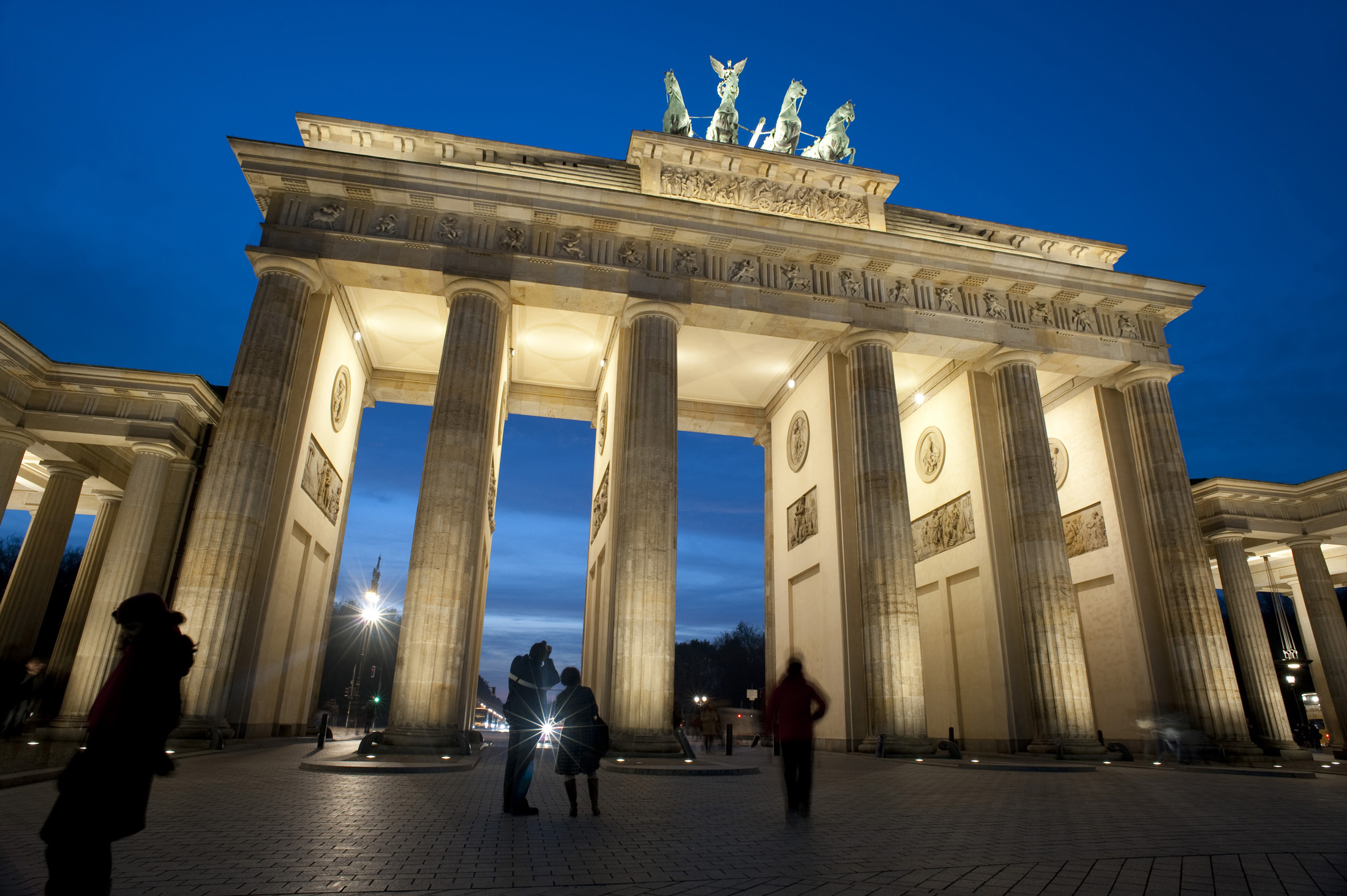 a floodlit view of the brandenburg gate at night