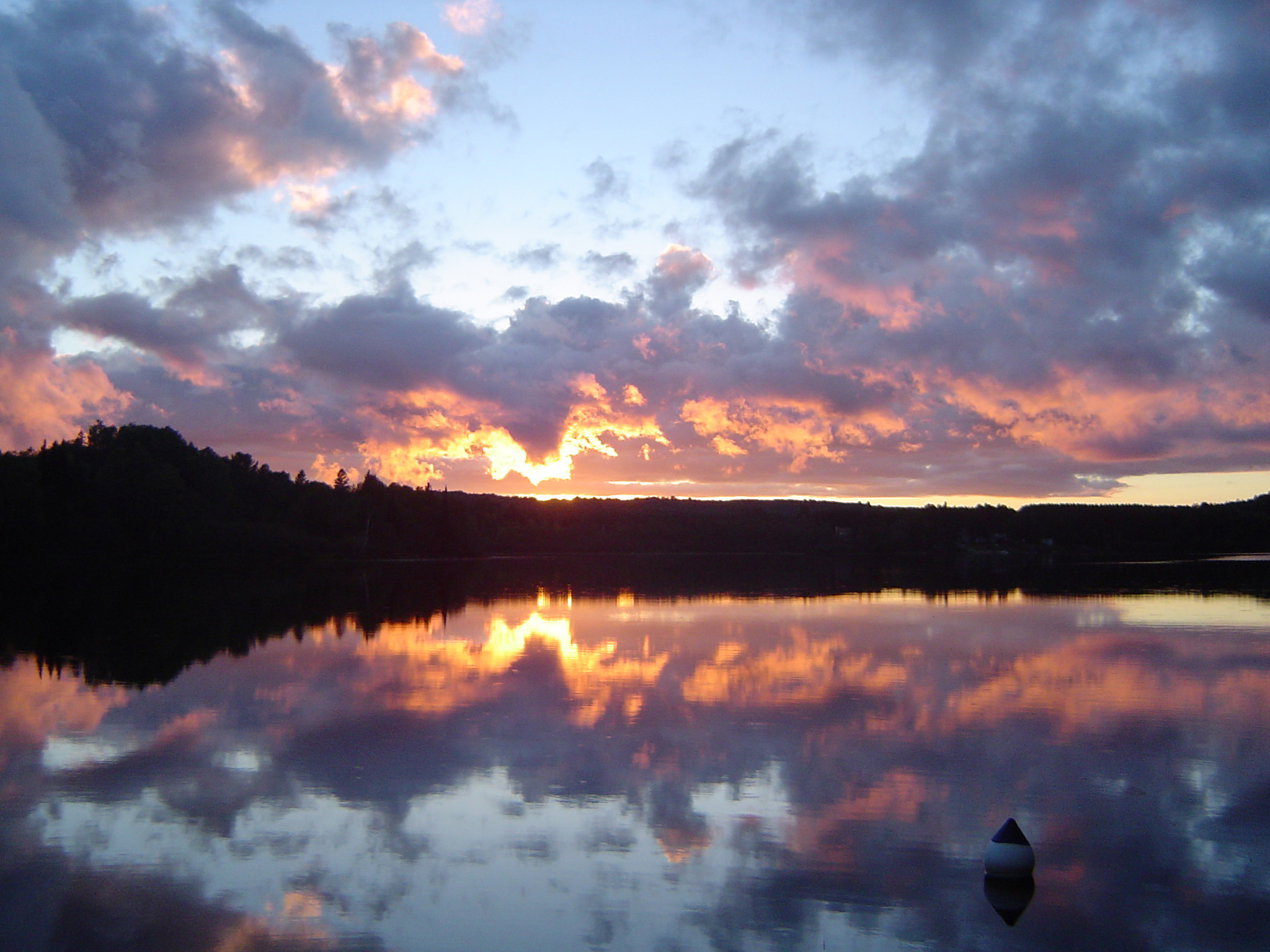 Sunset Behind Forest Hills Overlooking Lake in Algonquin Park, Ontario, Canada