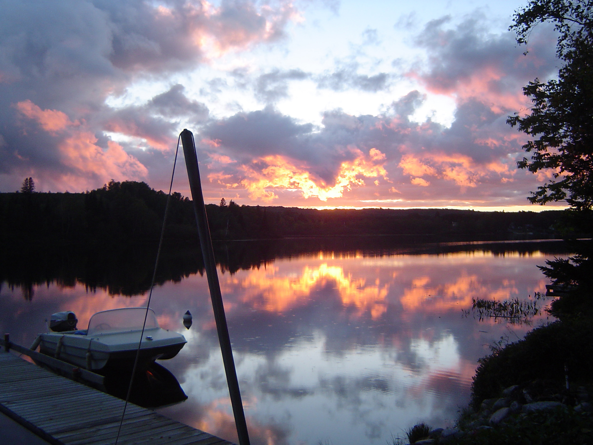 Boat at Dock on Lake at Sunset in Algonquin Park, Ontario, Canada