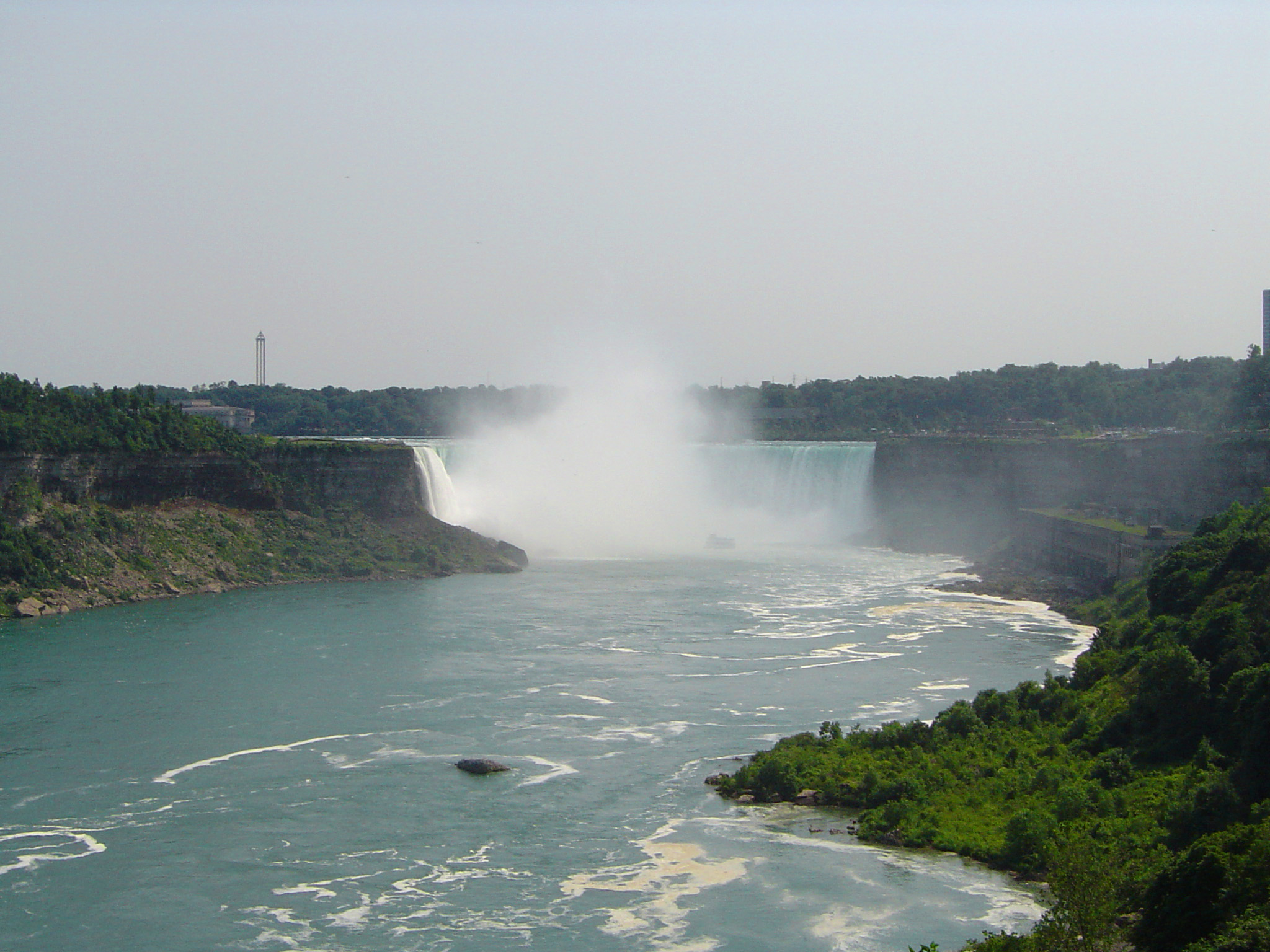 View down the Niagara River of the Horseshoe Falls at the Niagara Falls on the border between Canada and the USA