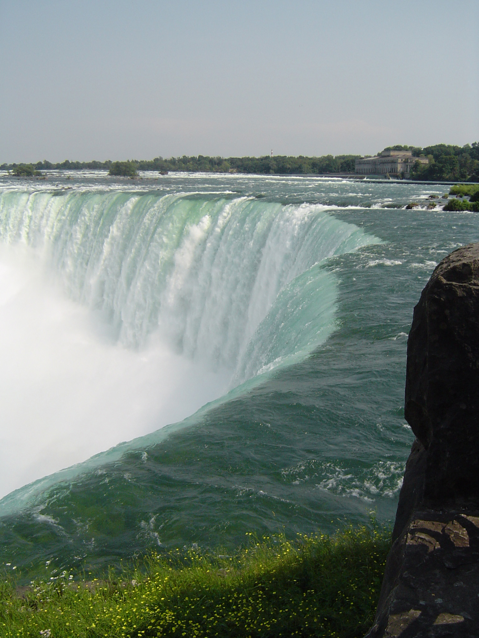Scenic view of the Niagara Horseshoe Falls on the border between Canada and the USA, high angle showing the river cascading over the clifff and rising spray