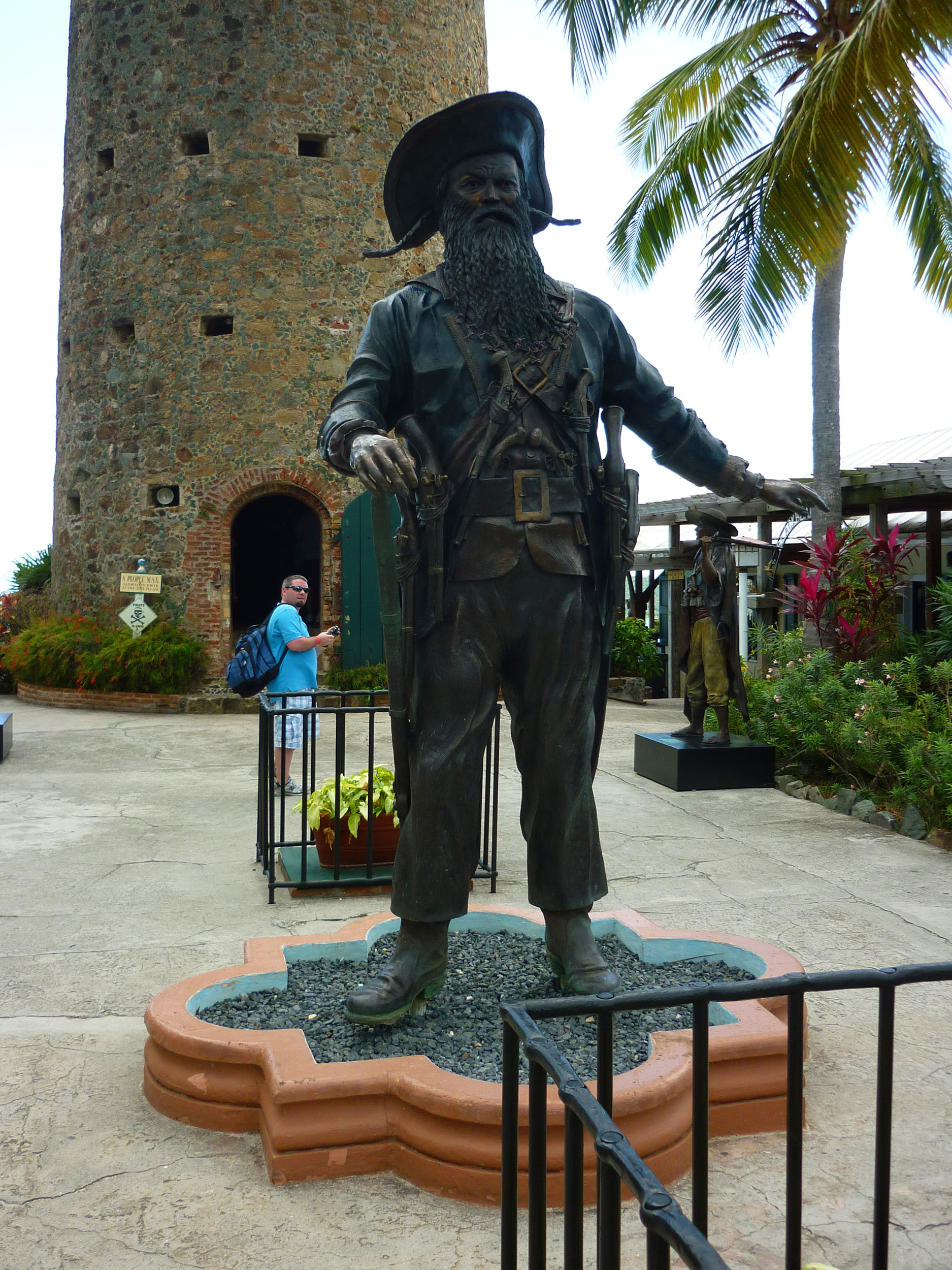 a statue of pirate blackbeard and his castle tower to the rear, St. Thomas, US virgin islands