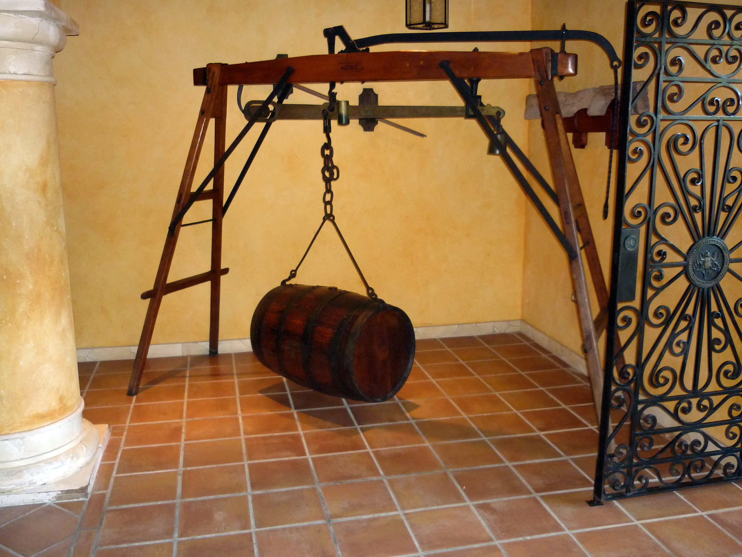 a rum barrel hung from a scale