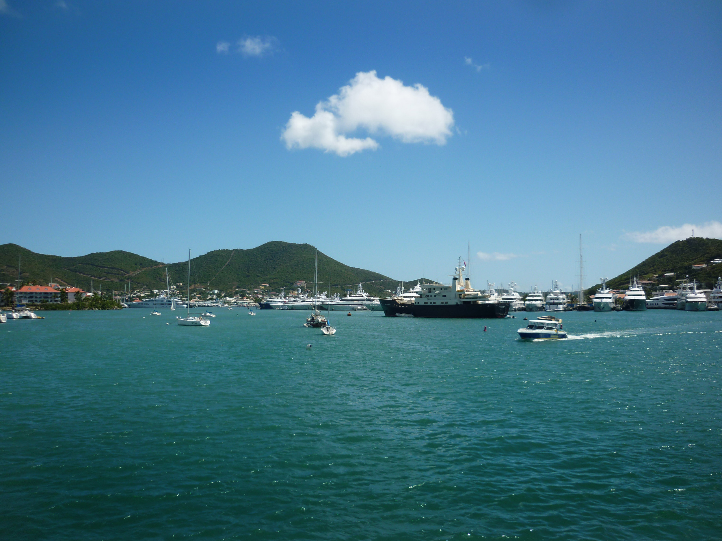 curise boats and motor yachts in the harbour at st maarten