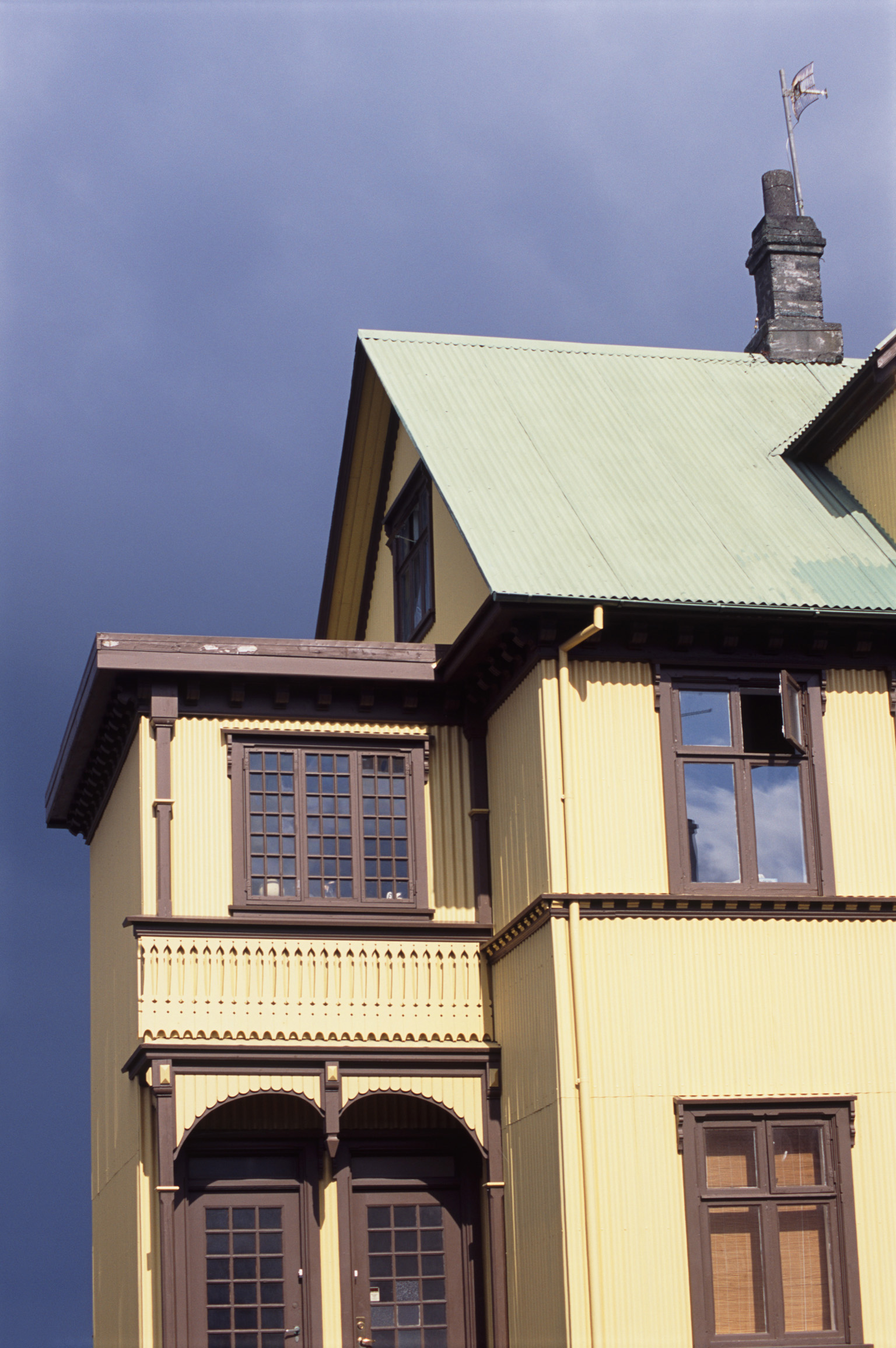 Exterior view of the typical architectural style of a Reykjavik house, Iceland against a blue sky