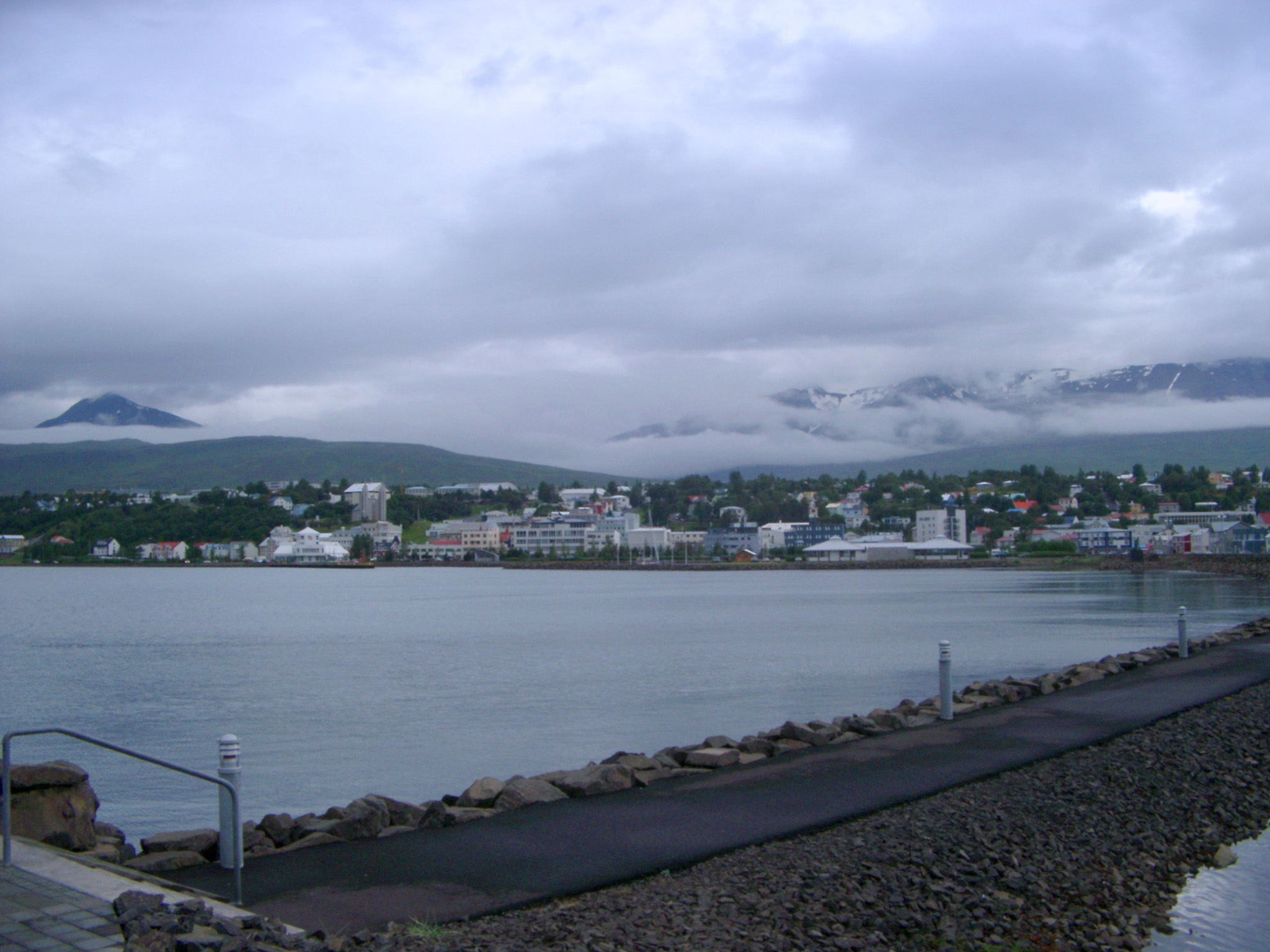 View of Akureyri from Across Eyjafjorour Fjord on Cloudy Grey Day, Iceland