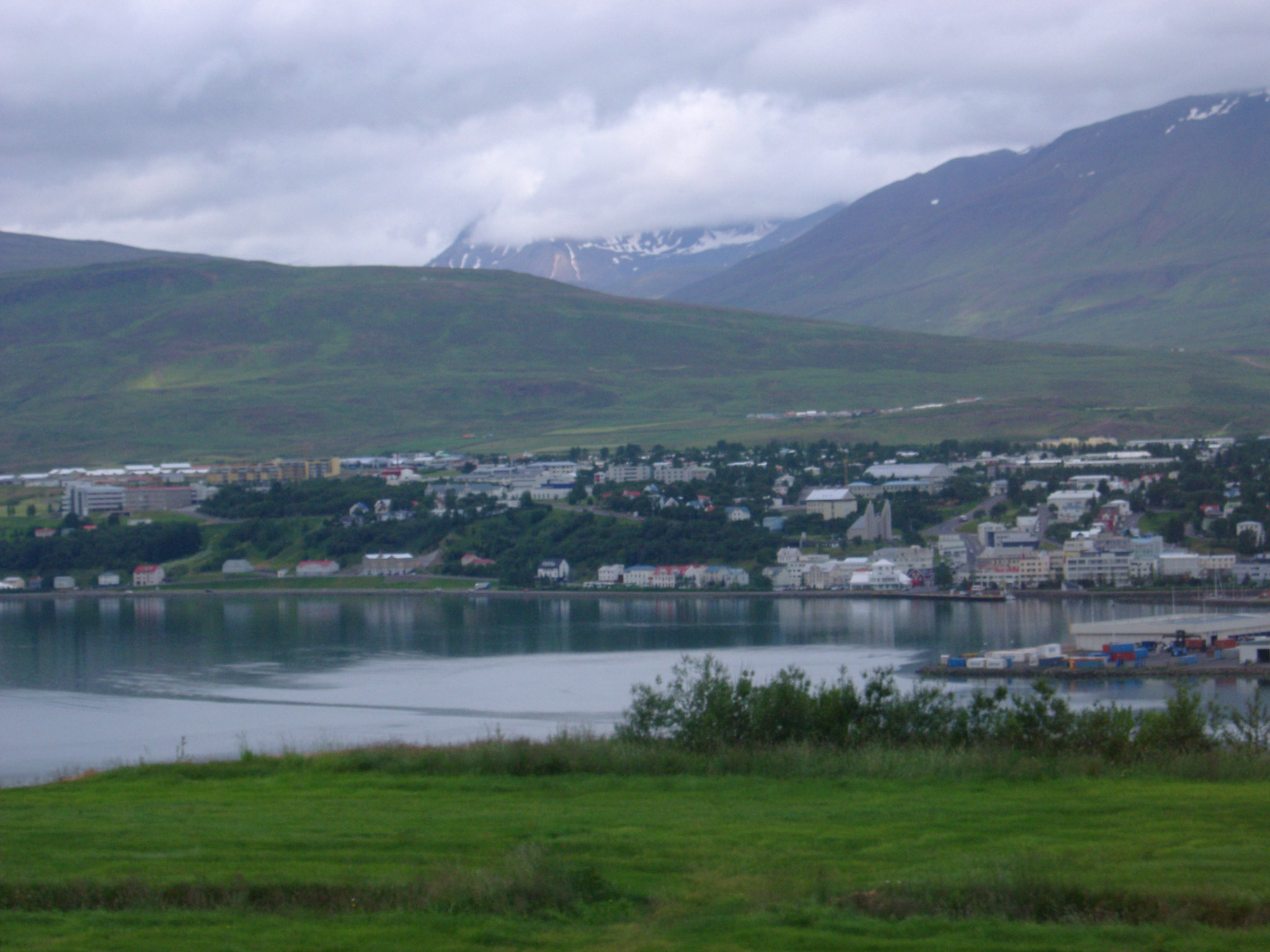 Town of Akureyri on Eyjafjorour Fjord with Overcast Sky and Mountains in the Distance