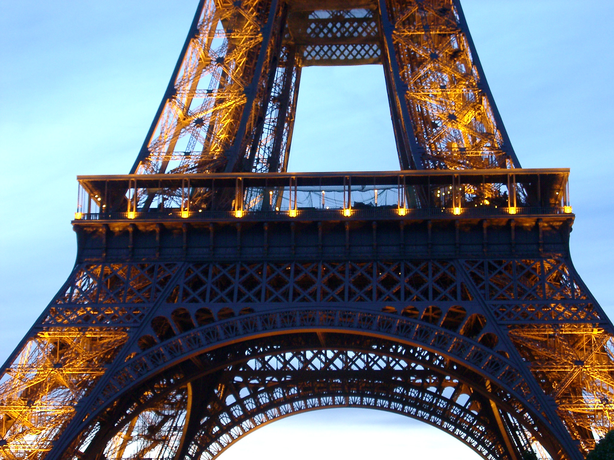 Detail of the Eiffel Tower, Paris, France showing the structure of the wrought iron lattice framework of the tower against a blue sky