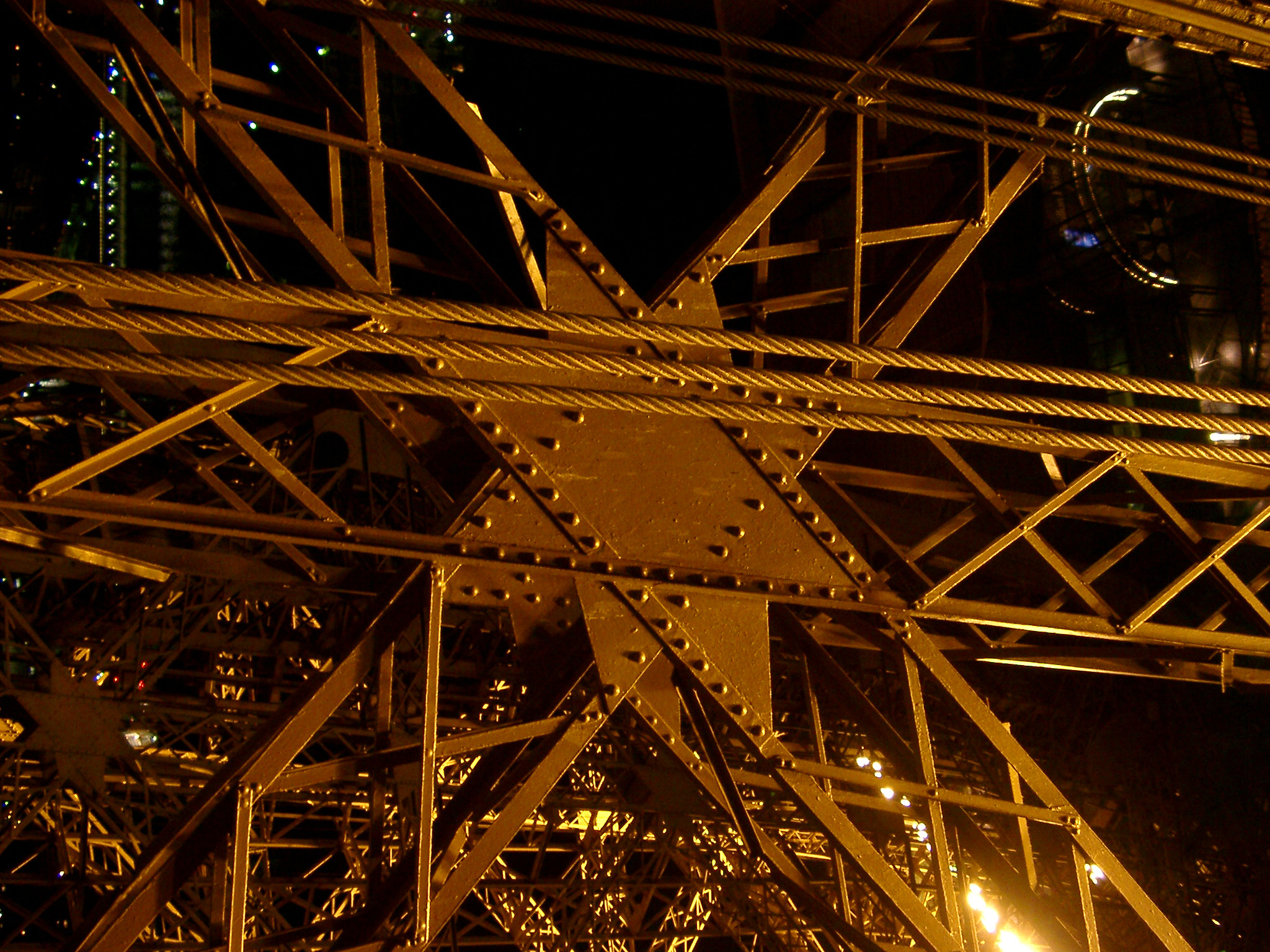 Close Up of Eiffel Tower Iron Lattice Structure with floodlights peeking through, Paris, France
