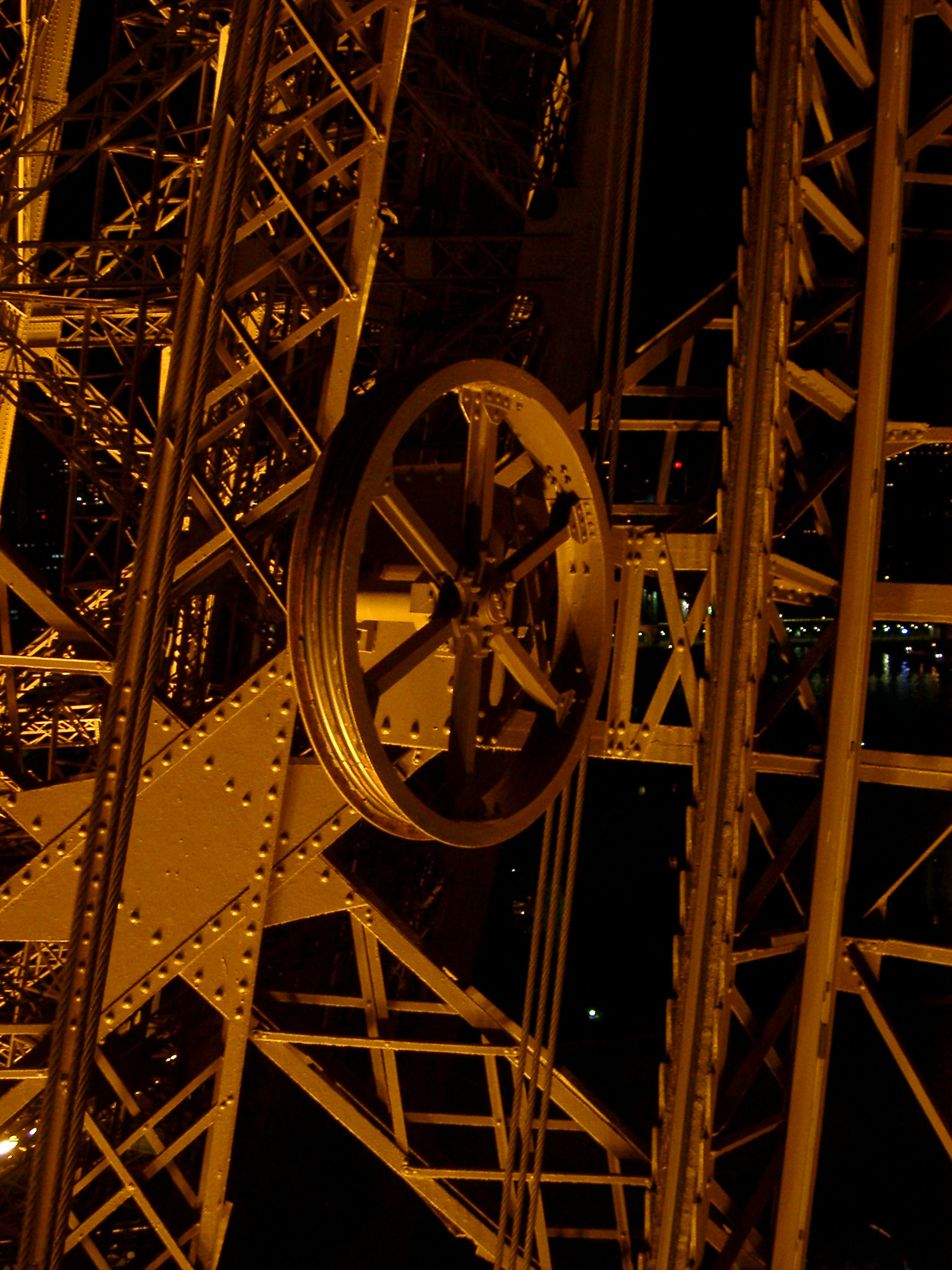 Eiffel Tower structure detail showing the wrought iron lattice framework and wheel