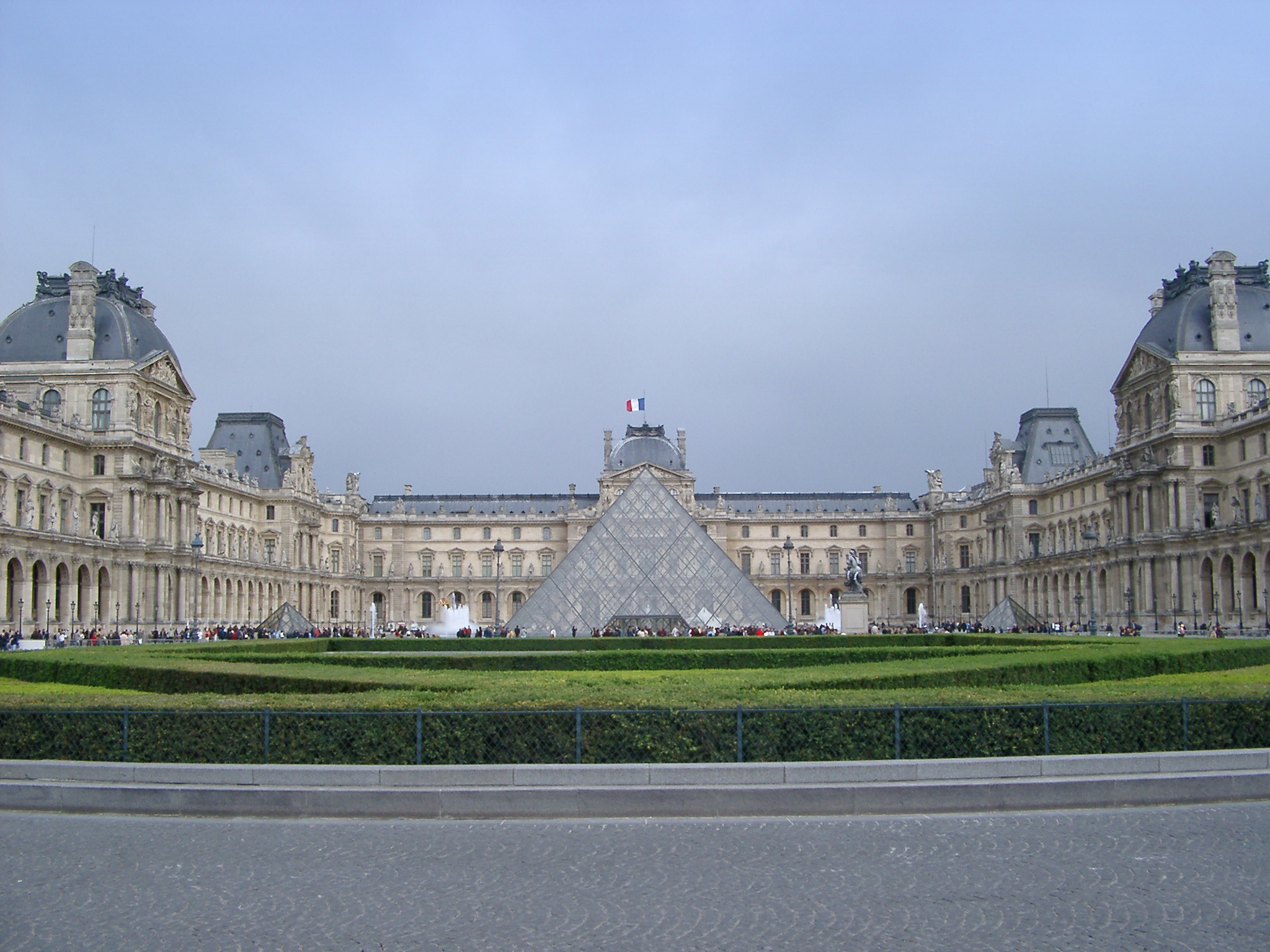 Exterior of Louvre Art Museum and Pyramide Inversee with Overcast Sky, Paris, France