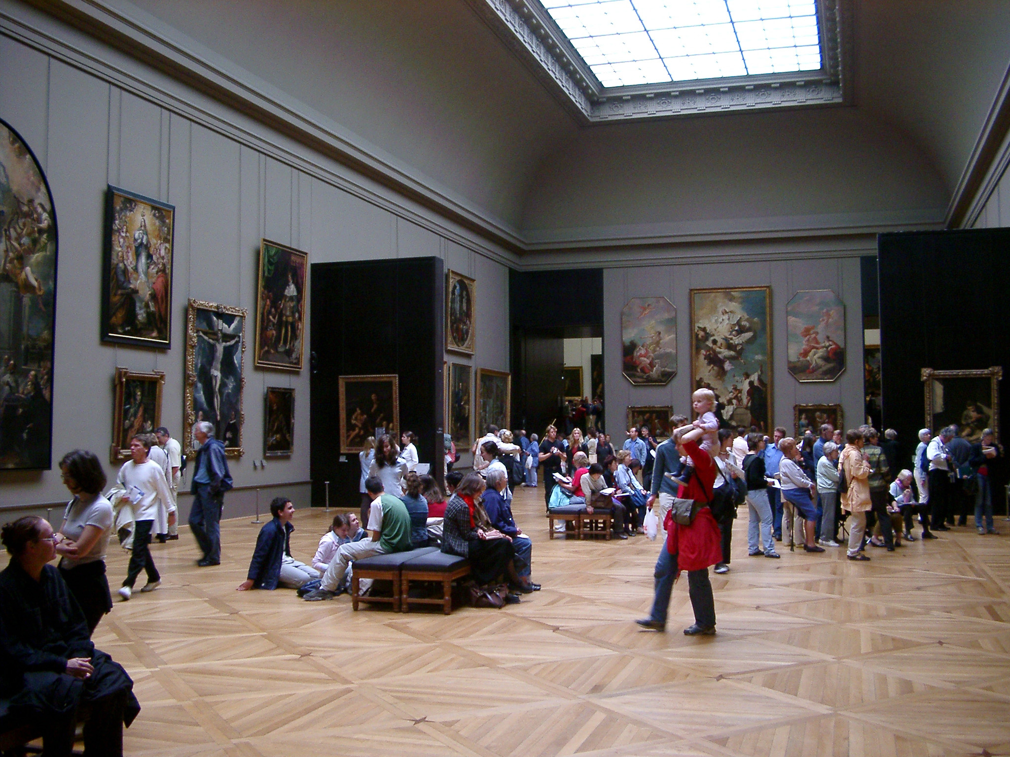 Crowds of visitors and tourists inside the Louvre Museum, Paris