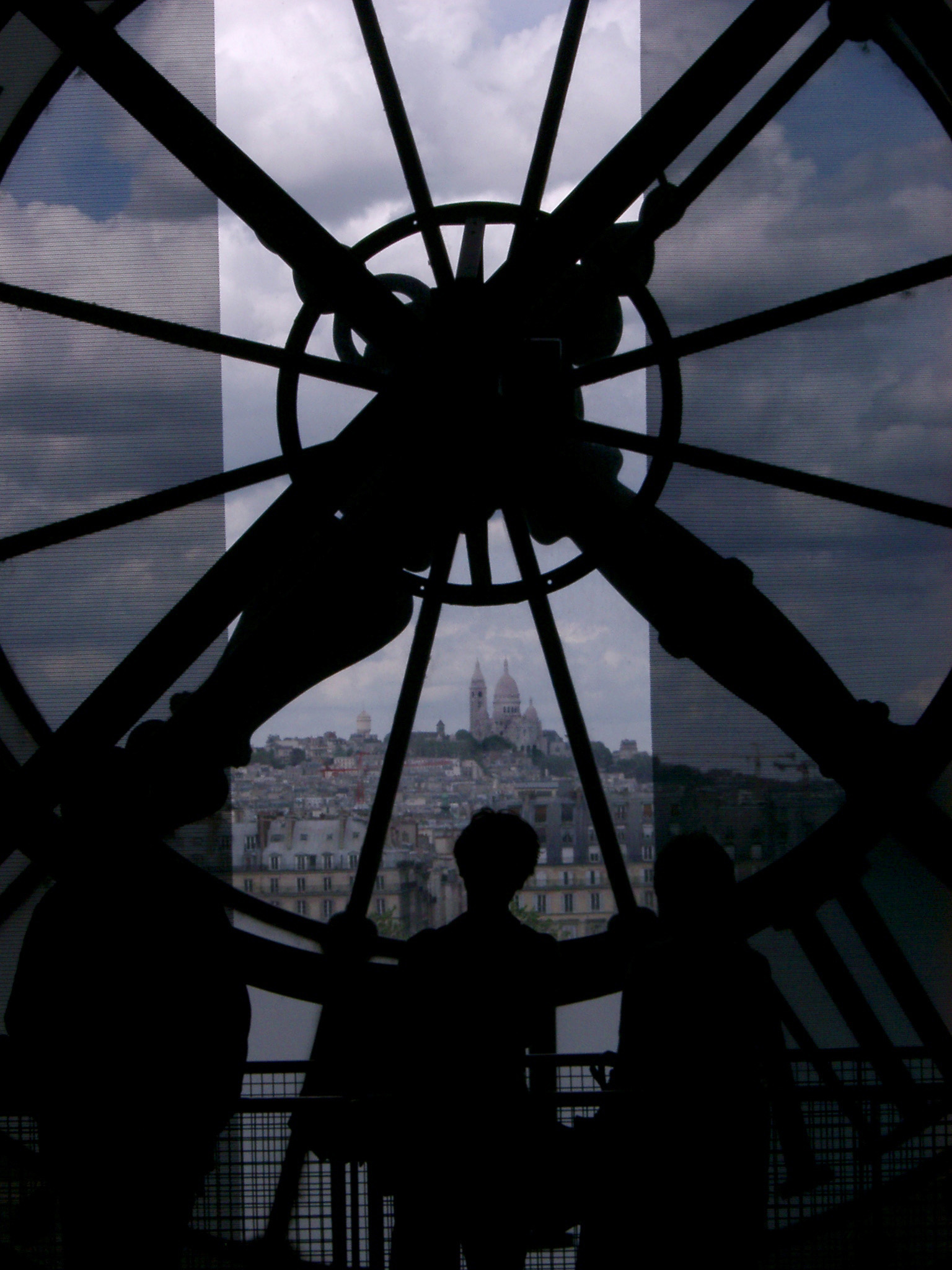 Silhouette of Person Admiring the View of Basilique du Sacre Coeur from Inside Musee d Orsay Clock Tower