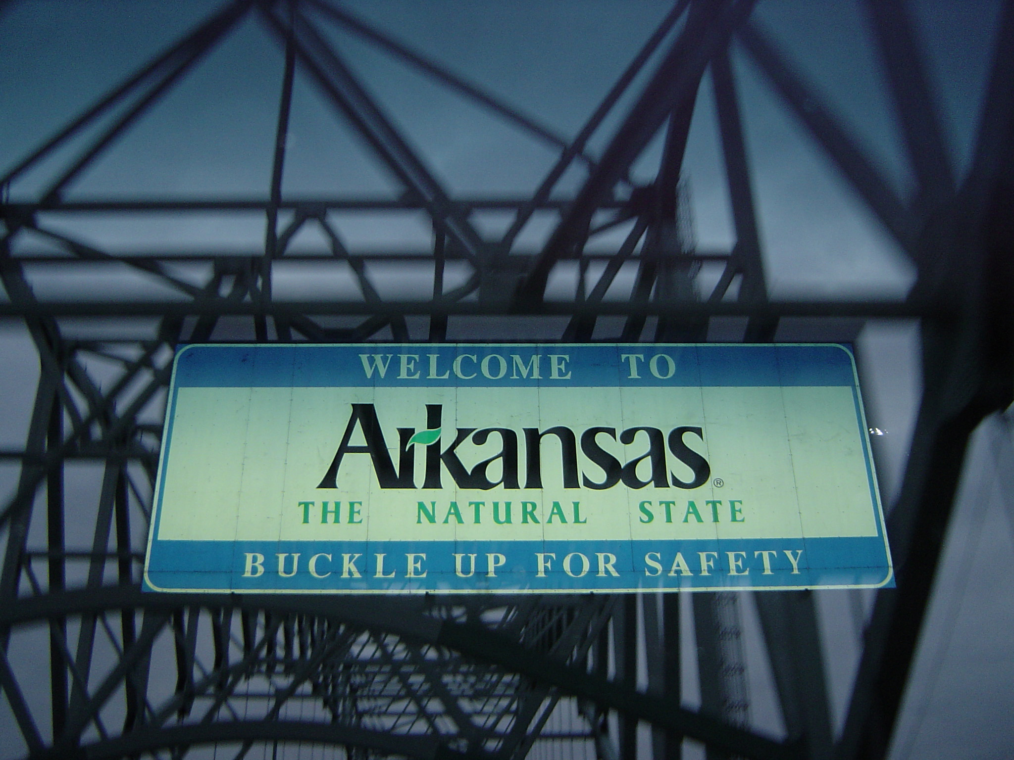 Macro Welcome Arkansas Sign on Interstate 40 West as the Highway Crosses the Mississippi River