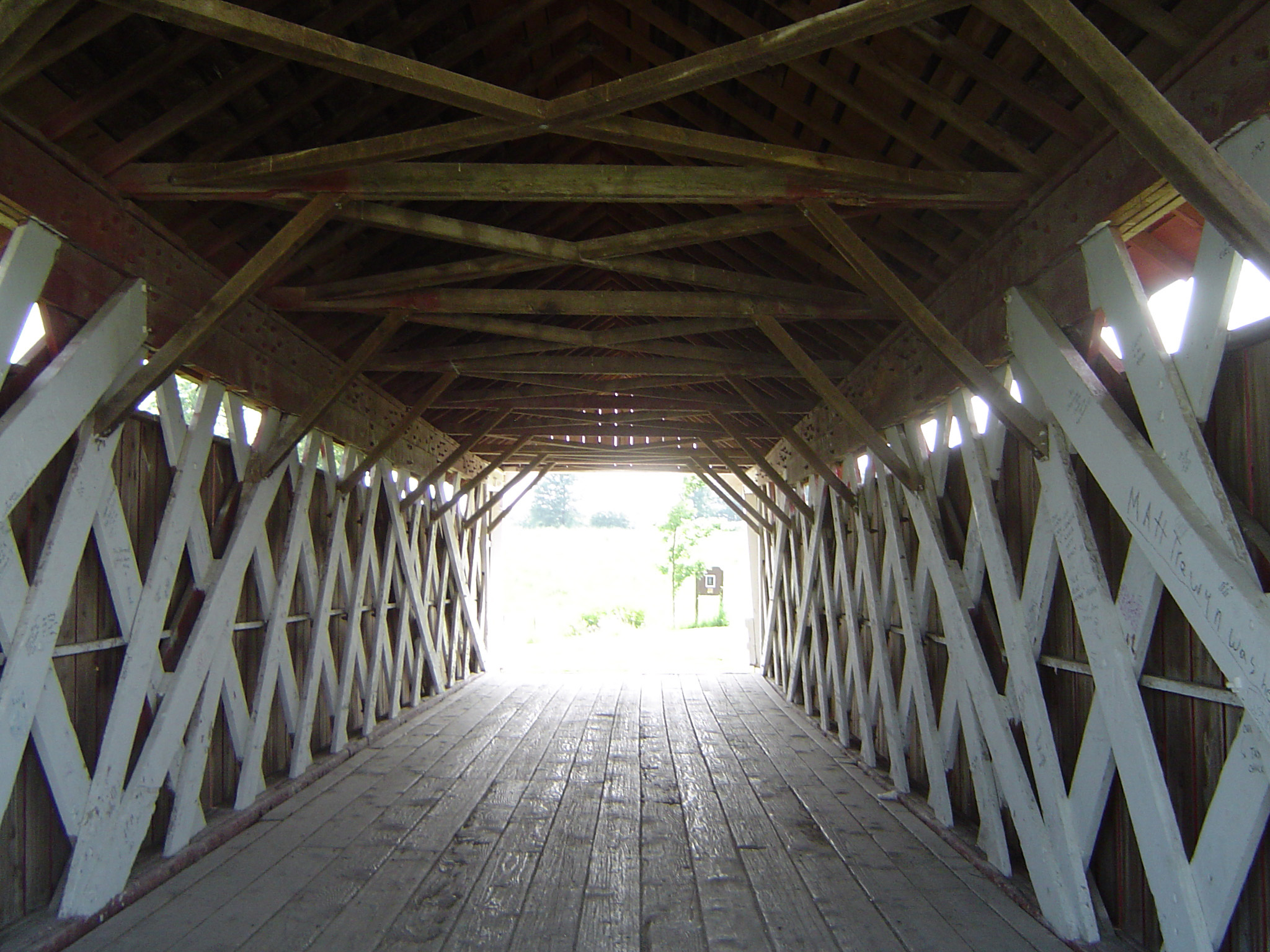 Interior of a historical American covered wooden bridge in Madison County showing the lattice framework