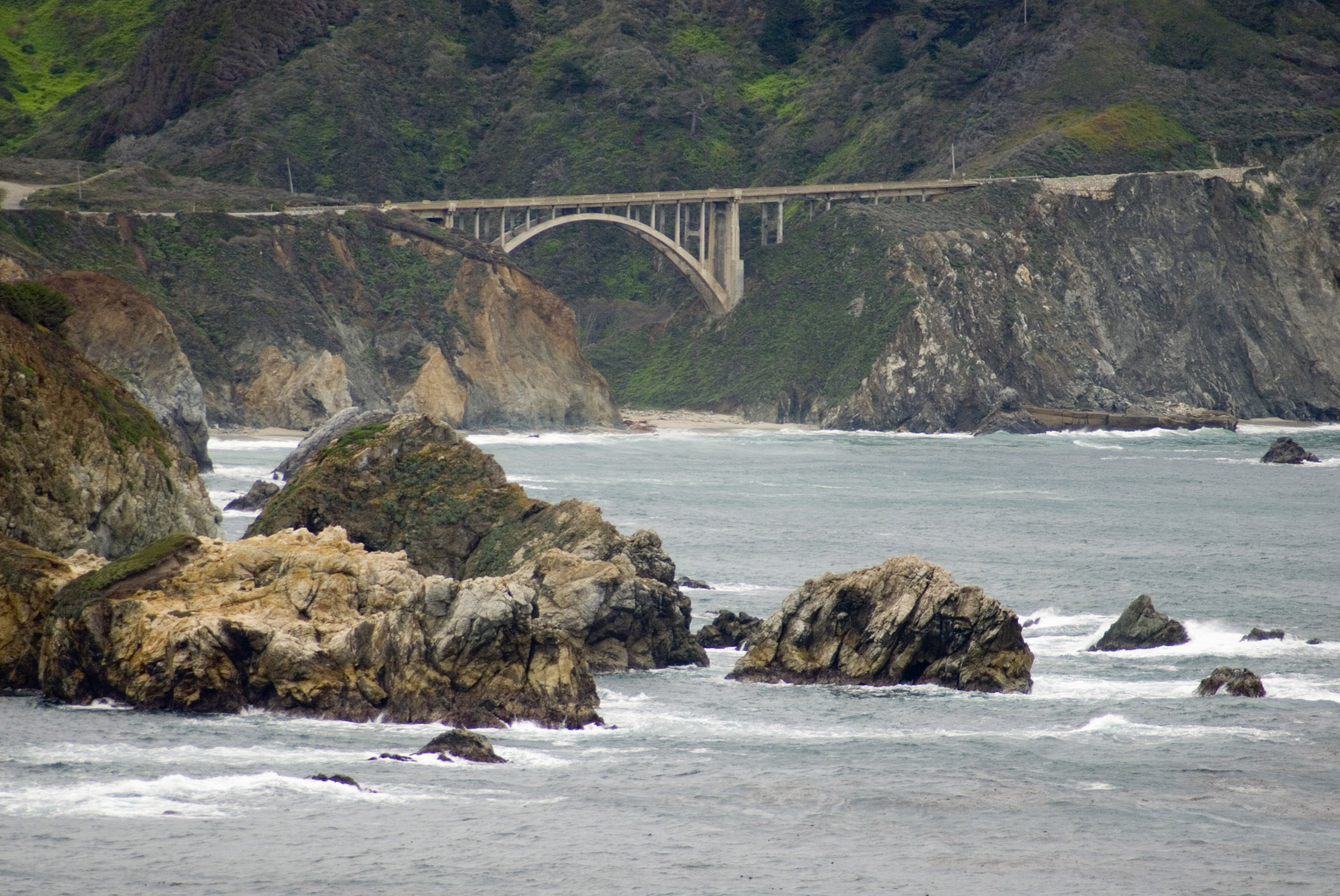 Rocky Creek road bridge, Big Sur, Callifornia, a landmark arched concrete bridge spanning a canyon on the coastline