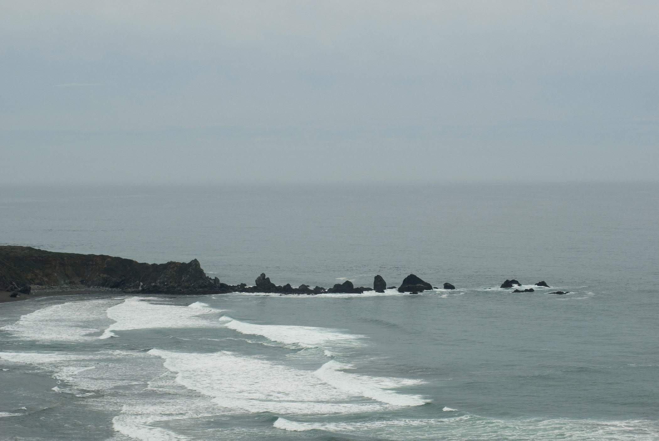 Calfornia Coastline and Rock Formations Along Big Sur Under Overcast Sky