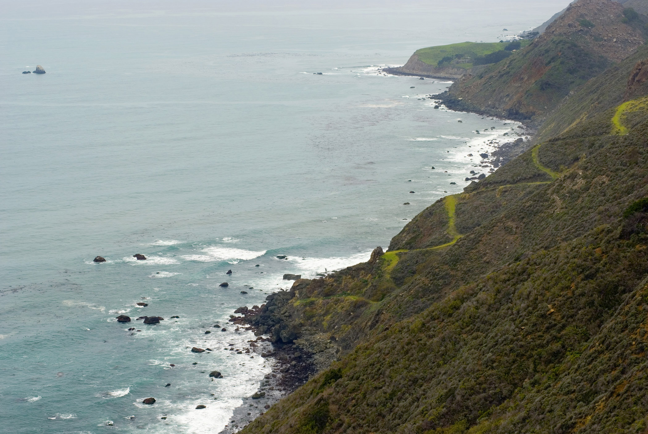 Beautiful Big Sur Coast with Grassy Hill in Aerial View. A Perfect Place for Vacation.