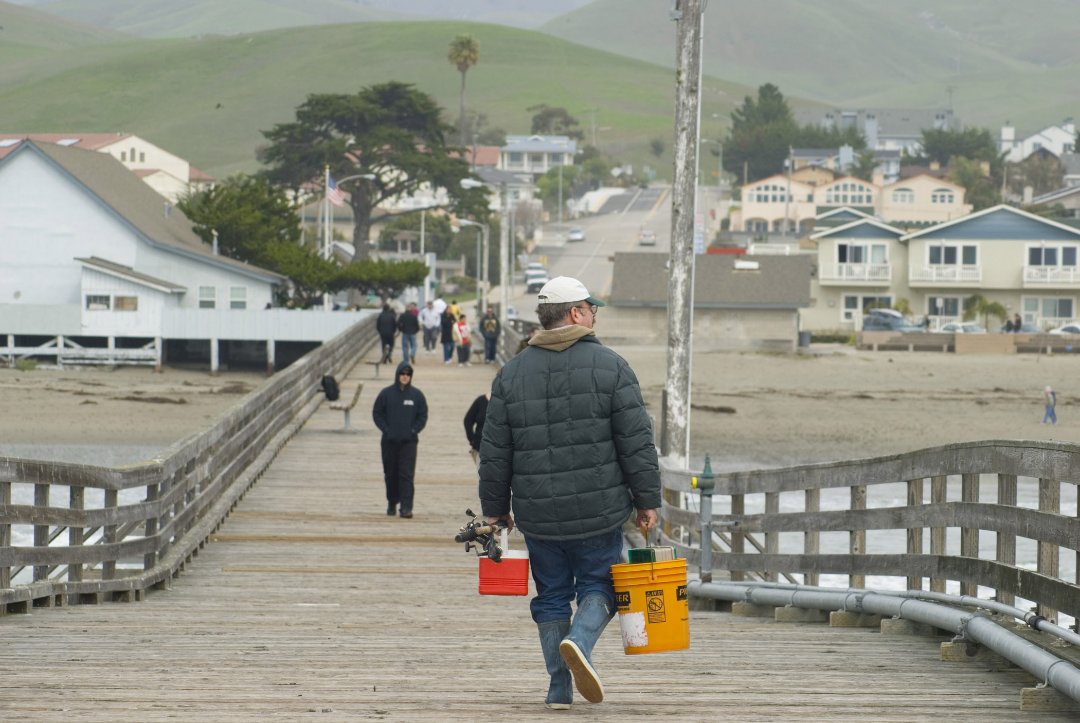 Fisherman with Buckets on Cayucos Pier, California, USA