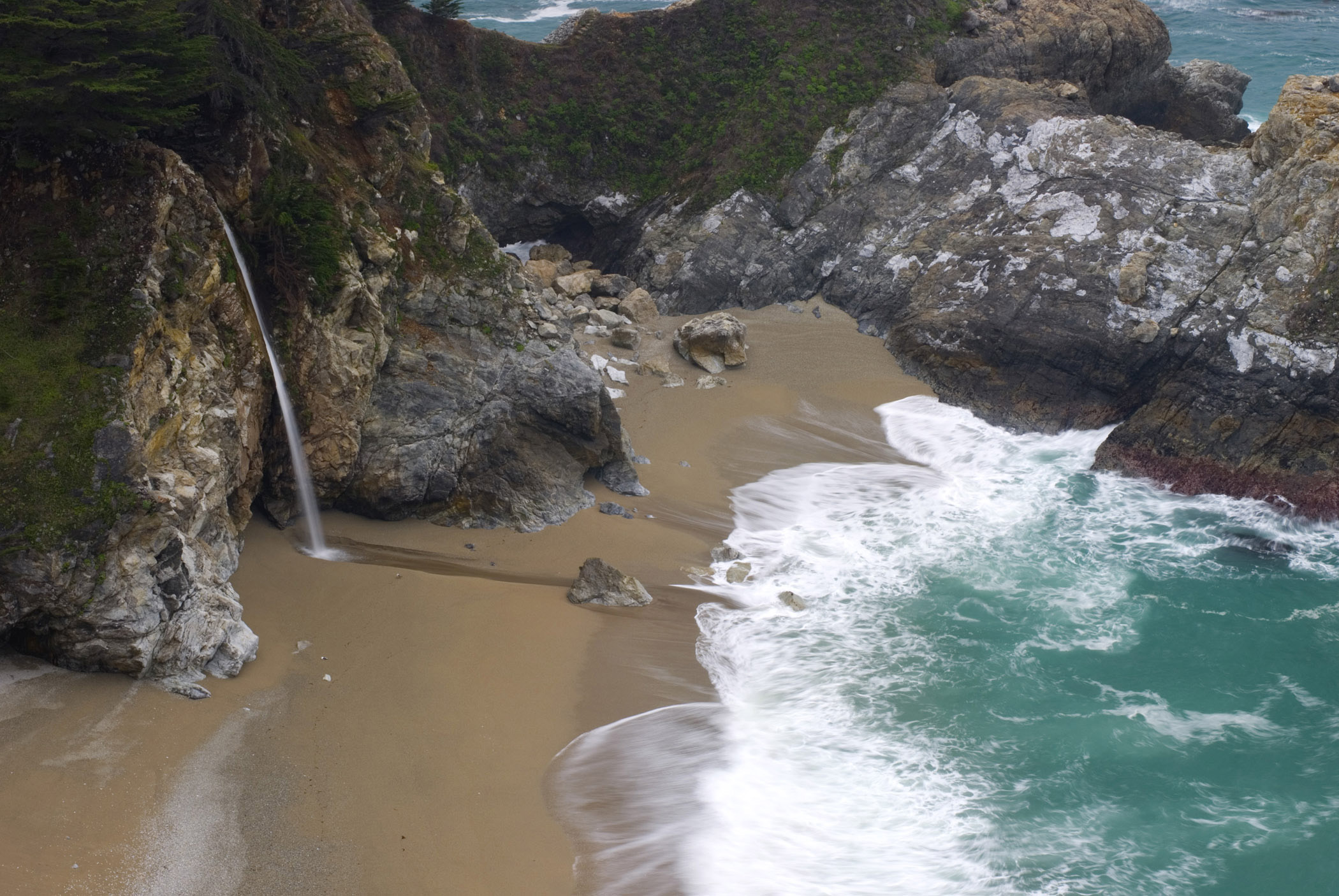 Beautiful McWay Falls in Front the Blue Water Sea in Aerial View