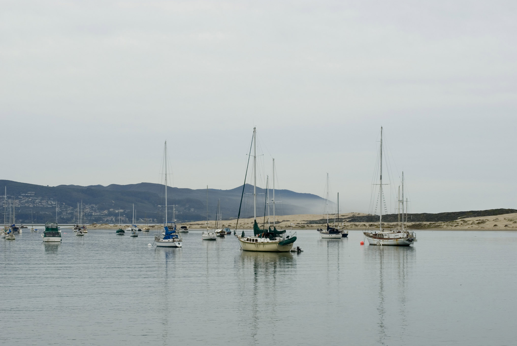 Sailboats Anchored in Morro Bay, California Under Overcast Sky
