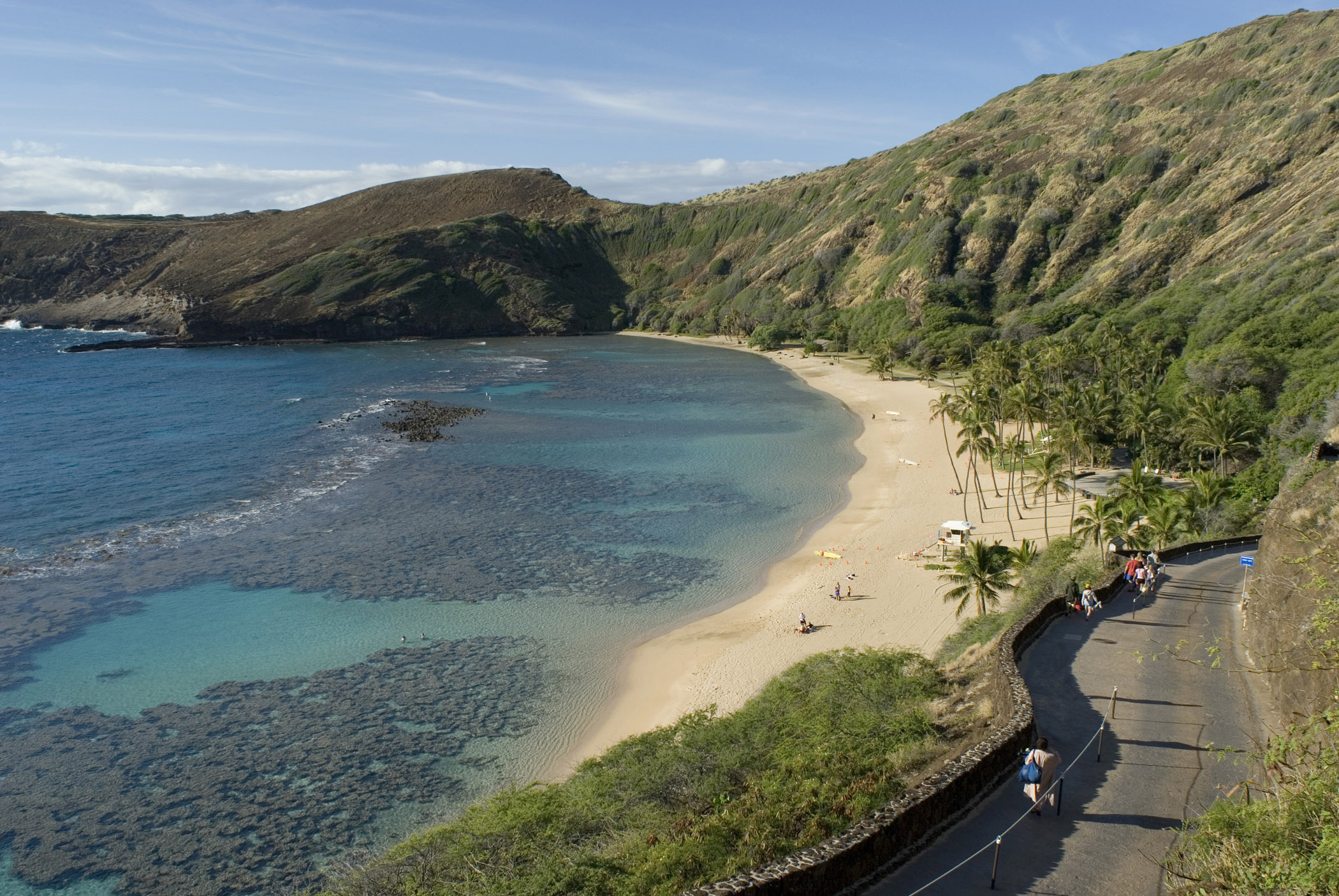Scenic view of the golden sand of Hanuma Bay Beach, Ohau, Hawaii, a favorite spot for snorkeling and water sport