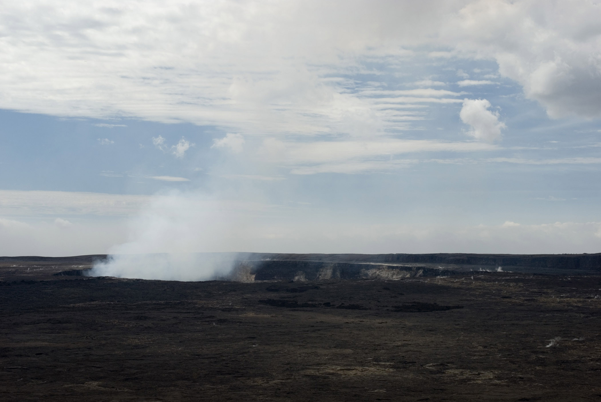 Smoke at Volcanoes National Park in Hawaii. Isolated on Lighter Blue and White Sky Background.