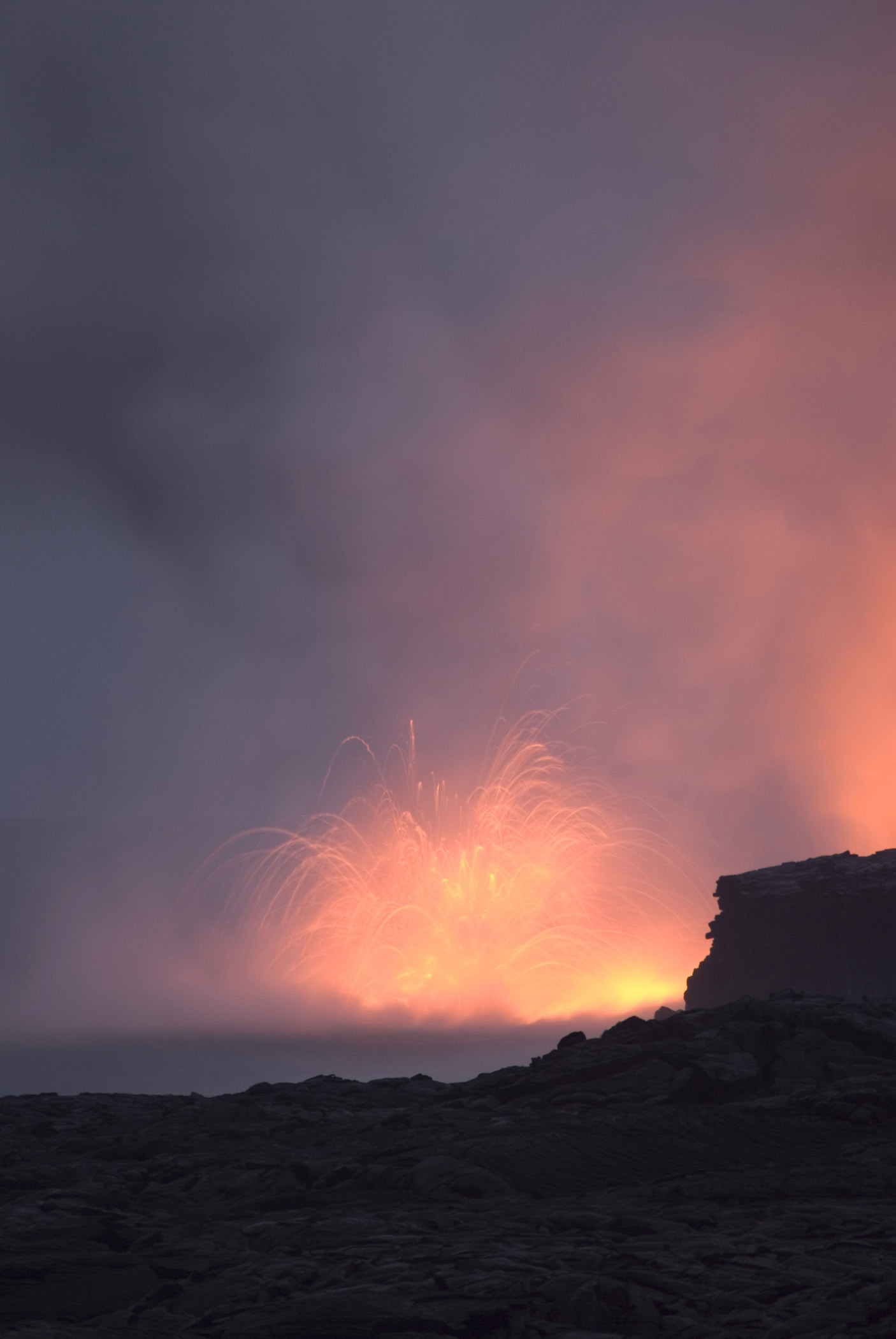 Smoke From Red Hot Volcanic Lava Captured a Night.