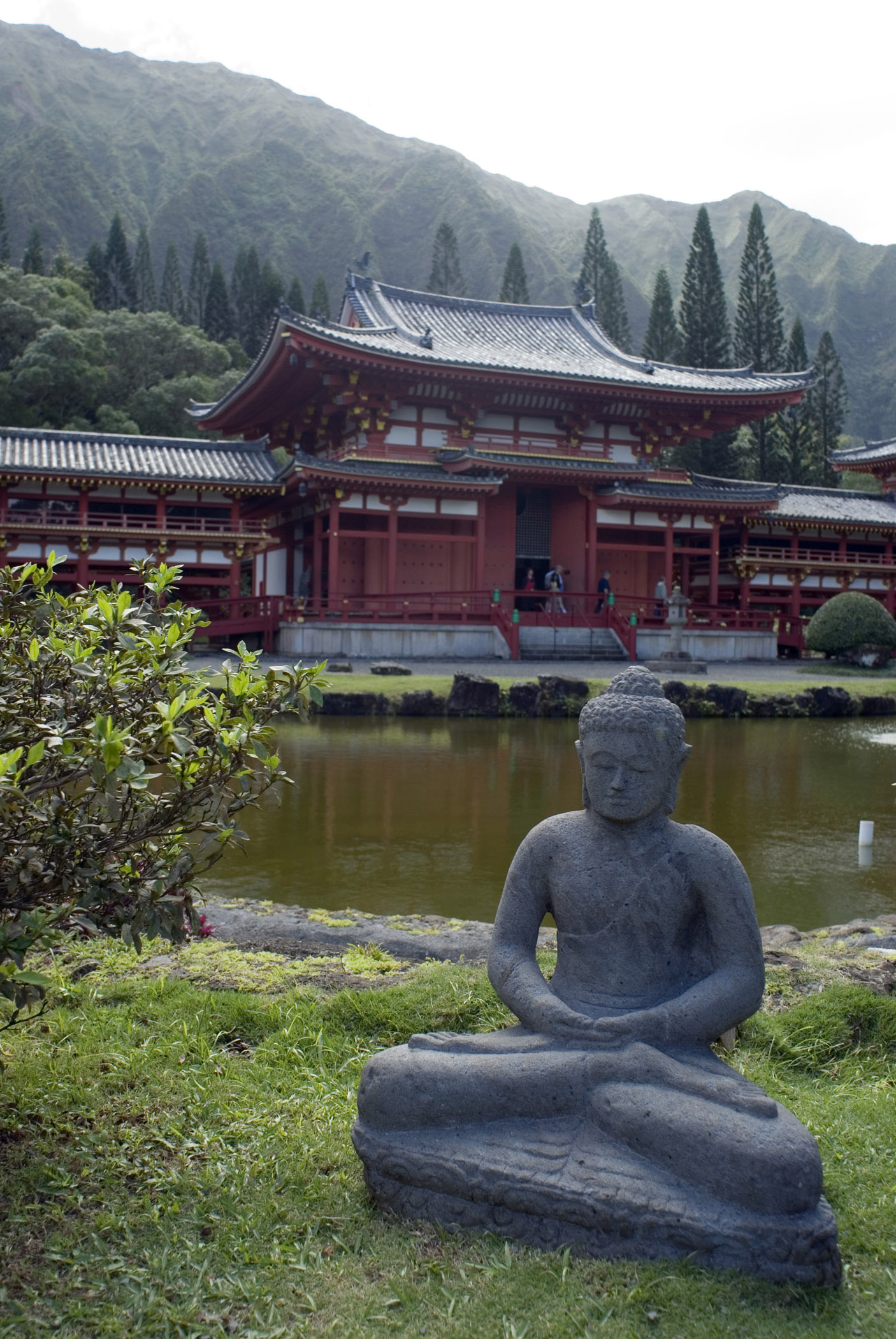 Vintage Sculpture at the Garden Water Side of Famous Byodo-In Buddhist Temple in Hawaii.