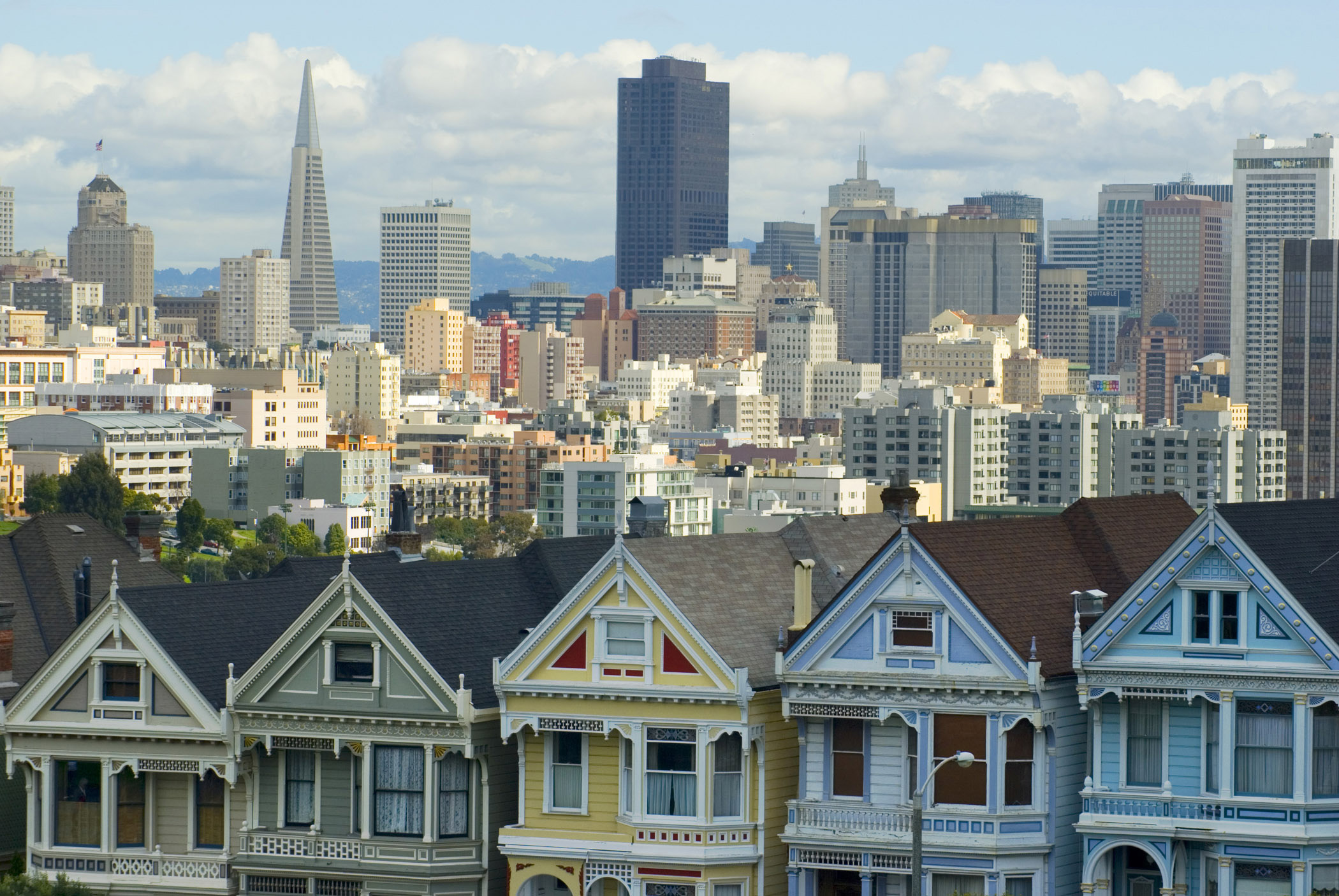 Attractive Architectural Building Structures at Alamo Square San Francisco with Lighter Blue and White Sky Background.