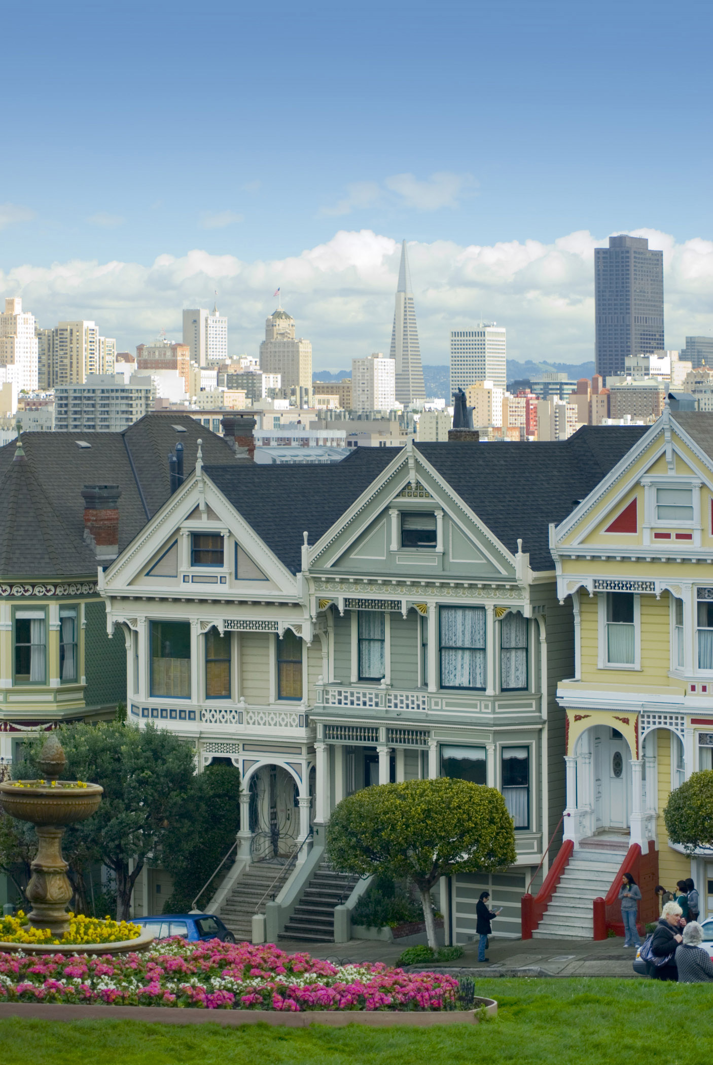 View of the Painted Ladies, a row of iconic landmark historical townhouses in Alamo Square, San Francisco, California, USA