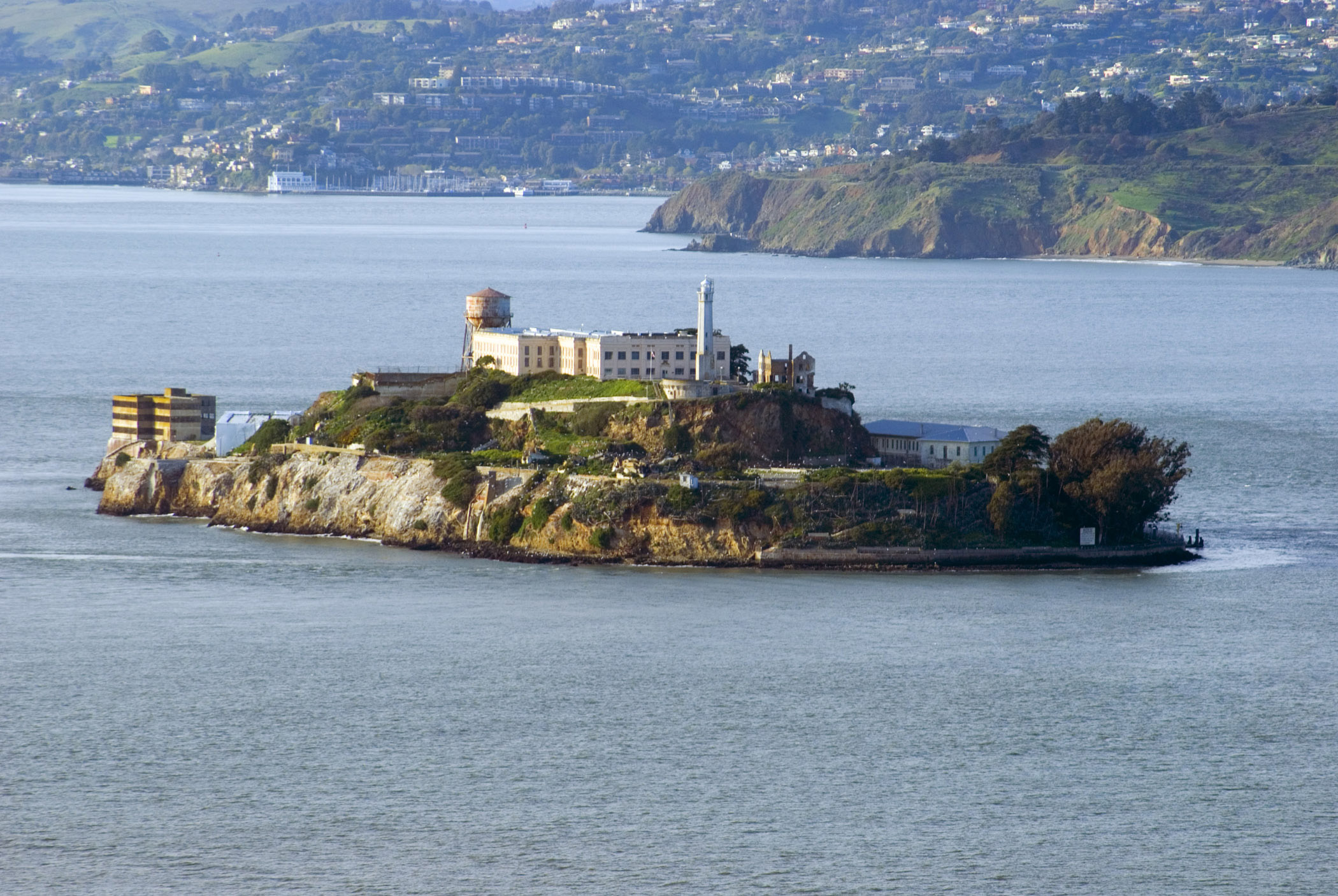 Scenic view of Alcatraz Island in San Francisco Bay with its famous impenetrable fortress prison, now decommissioned and a popular tourist attraction