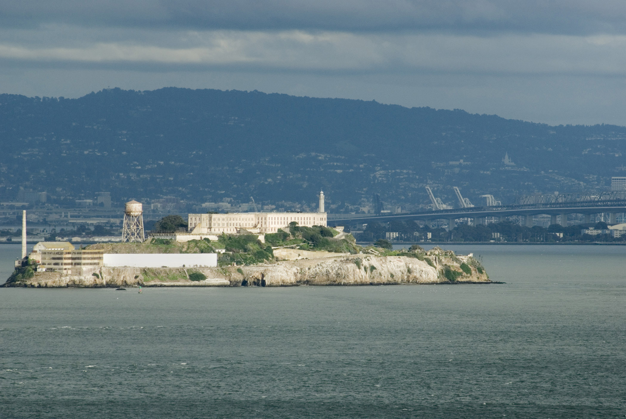 View of the disused Alcatraz Island prison buildings in San Francisco bay, now a popular tourist attraction